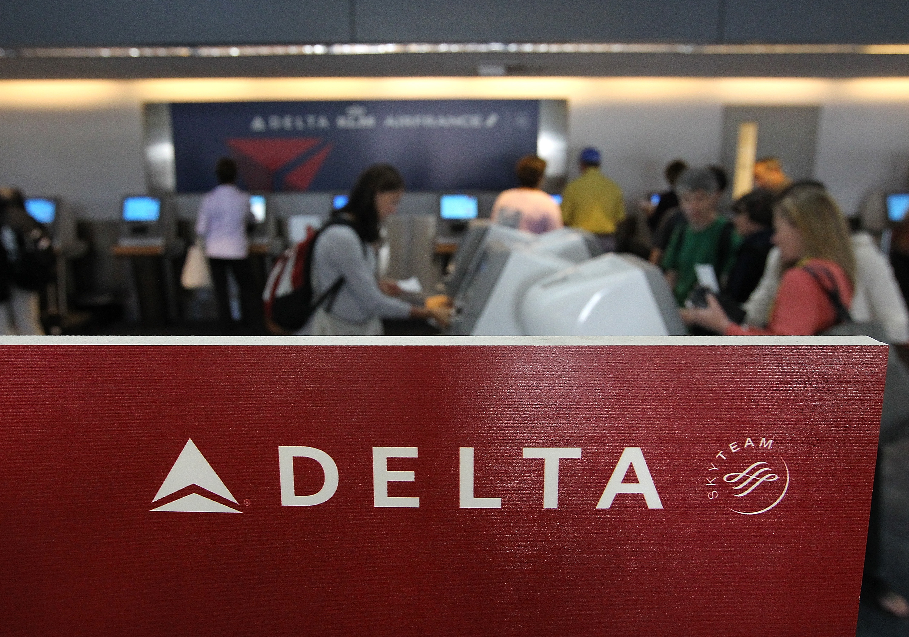 Delta Air Lines passengers use kiosks to check in for flights at San Francisco International Airport in California.