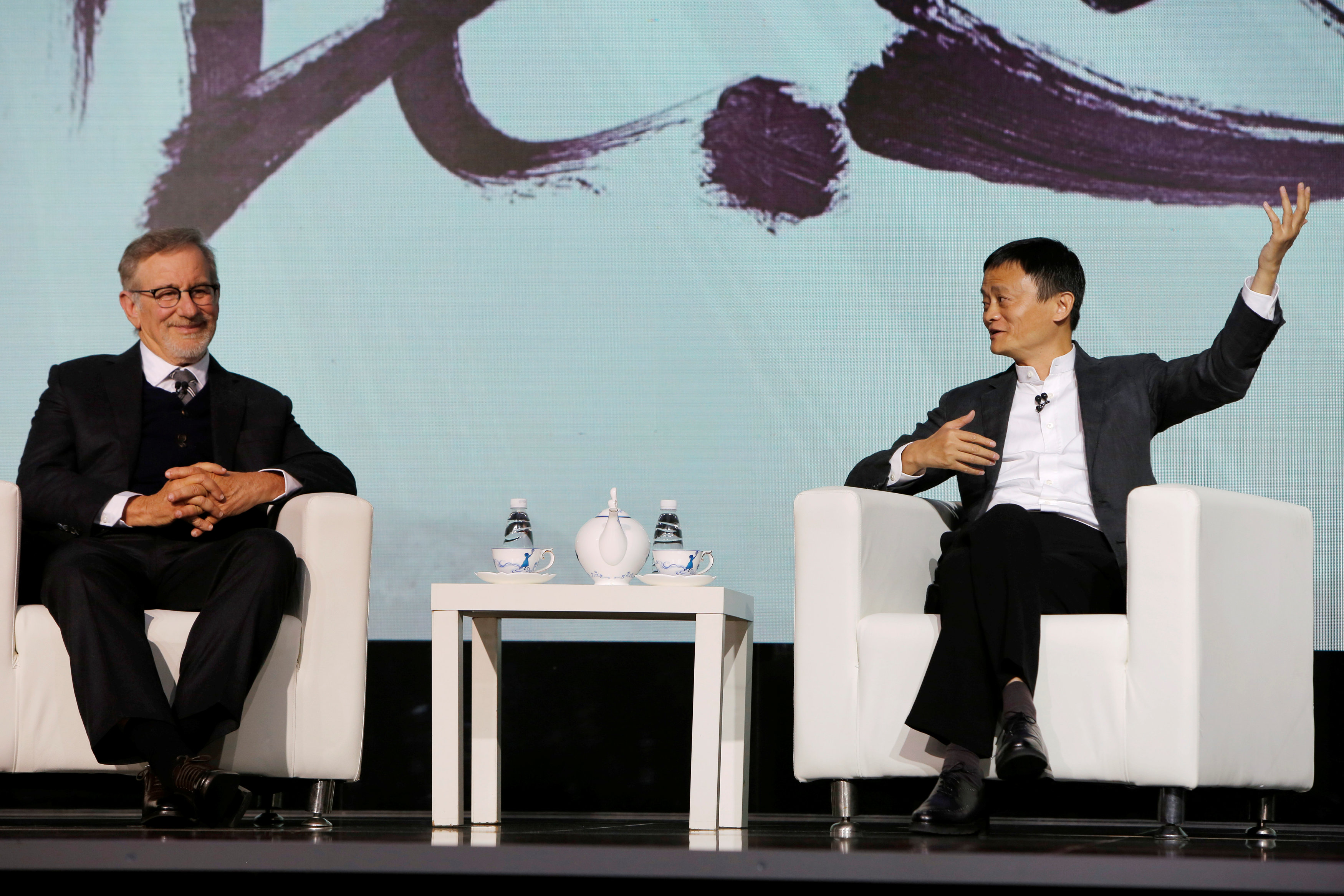 Steven Spielberg (L), film director and Chairman of Amblin Partners and Jack Ma, Chairman and chief executive of Alibaba Group attend an event to announce partnership between Alibaba Pictures Group Limited and Amblin Partners, in Beijing