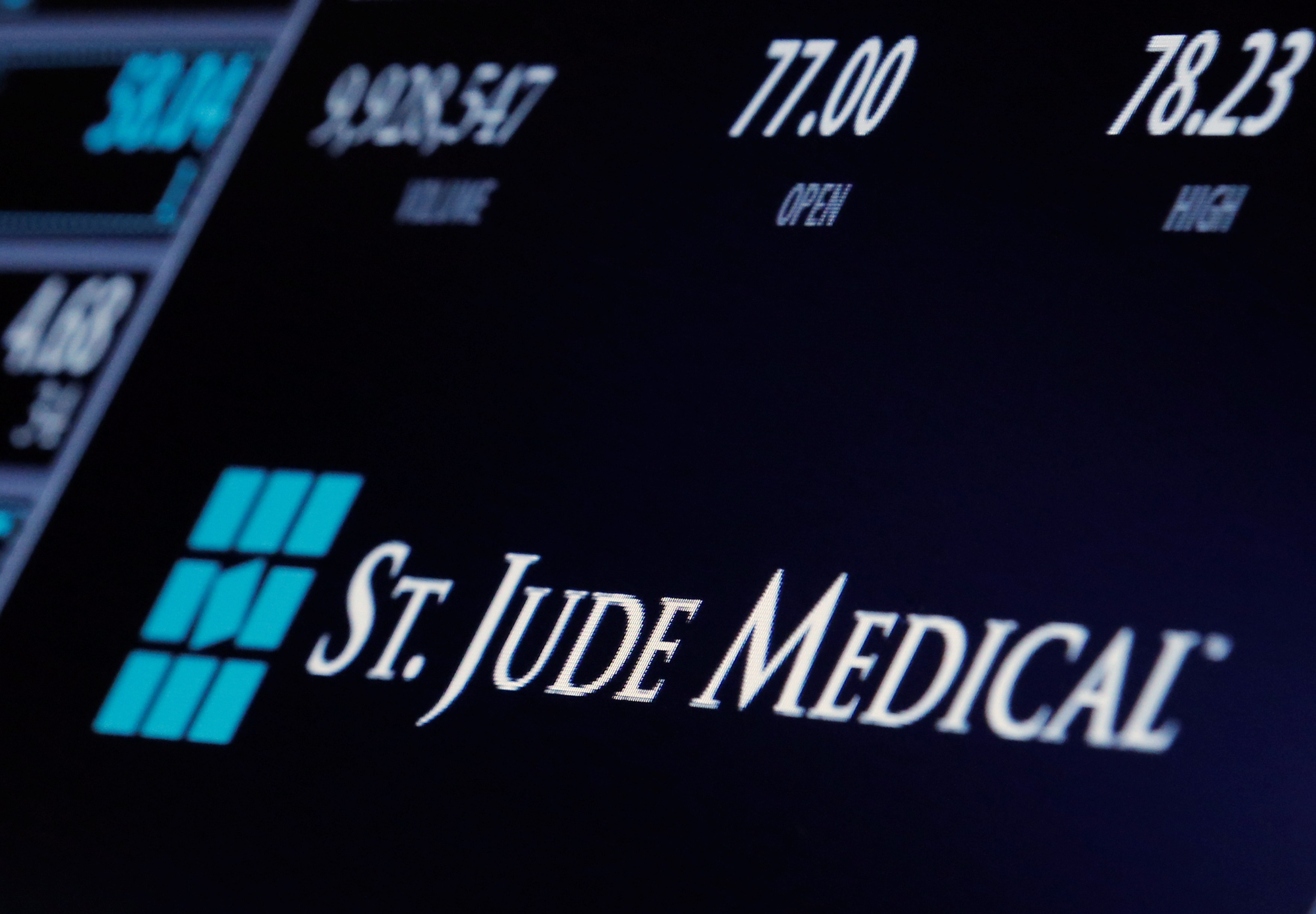 The ticker and trading information for St. Jude Medical is displayed where the stock is traded on the floor of the New York Stock Exchange.