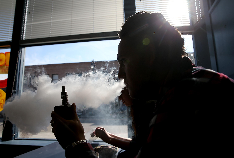 A customer smokes an E-Cigarette at Digita Ciggz on January 28, 2015 in San Rafael, California.