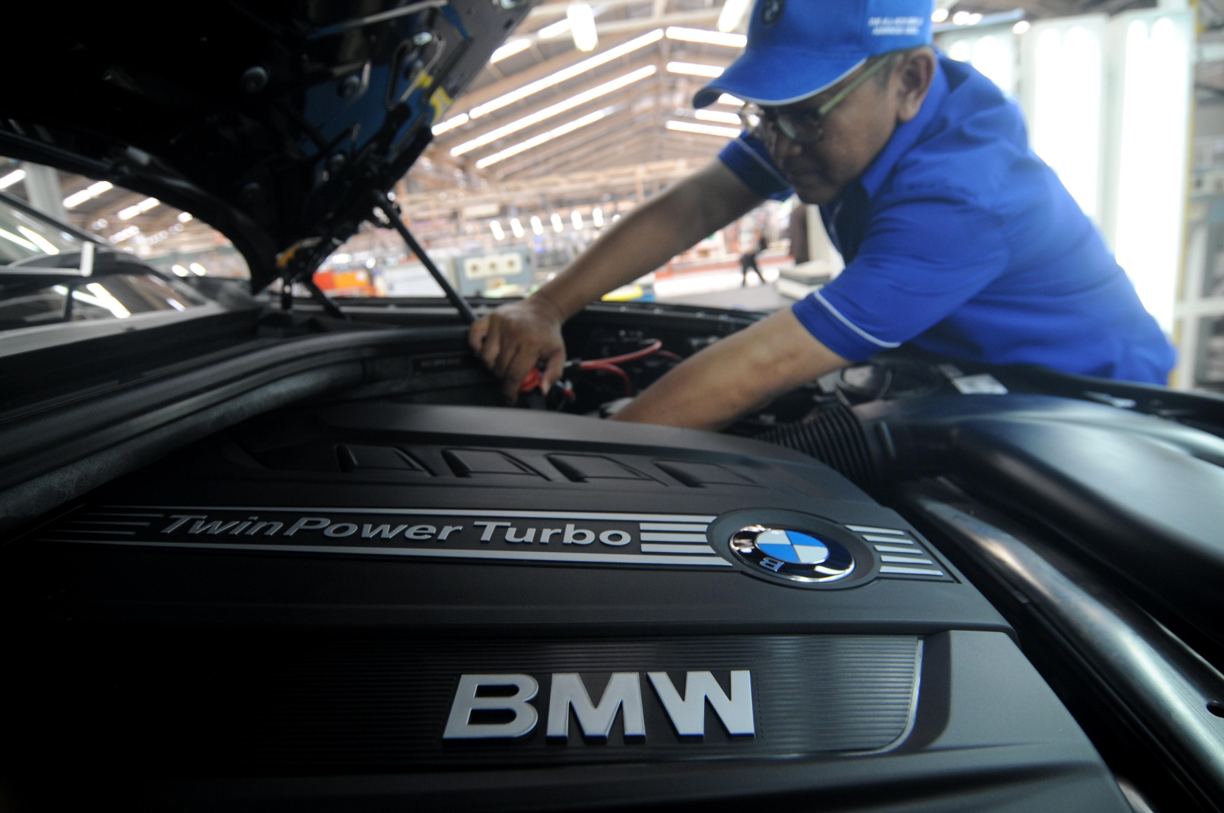 Workers assemble the third generation of BMW X5 Advance Diesel automobile in Jakarta, Indonesia, on April 10, 2015.