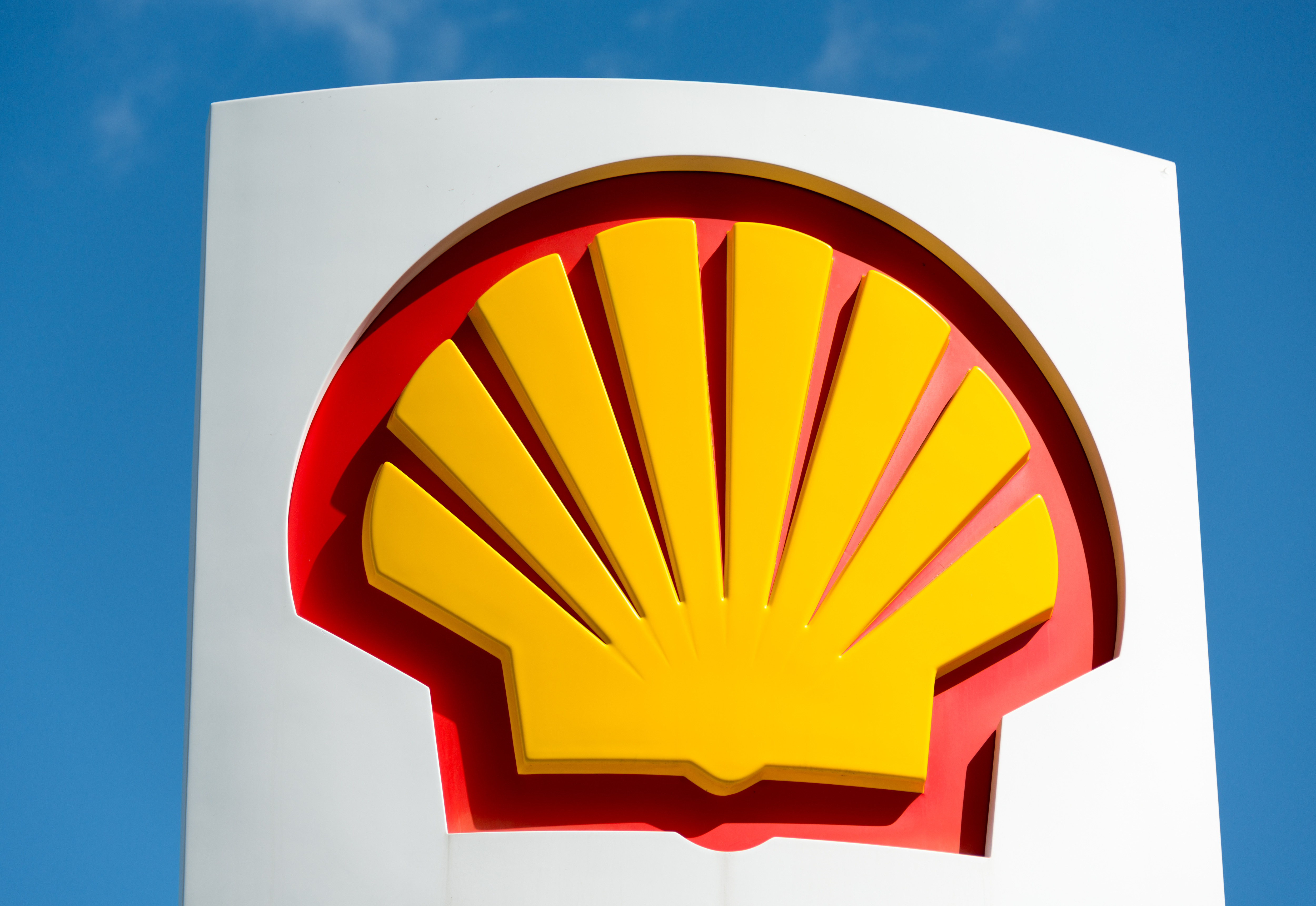 Icon of company Shell over blue sky: Shell Oil Company is