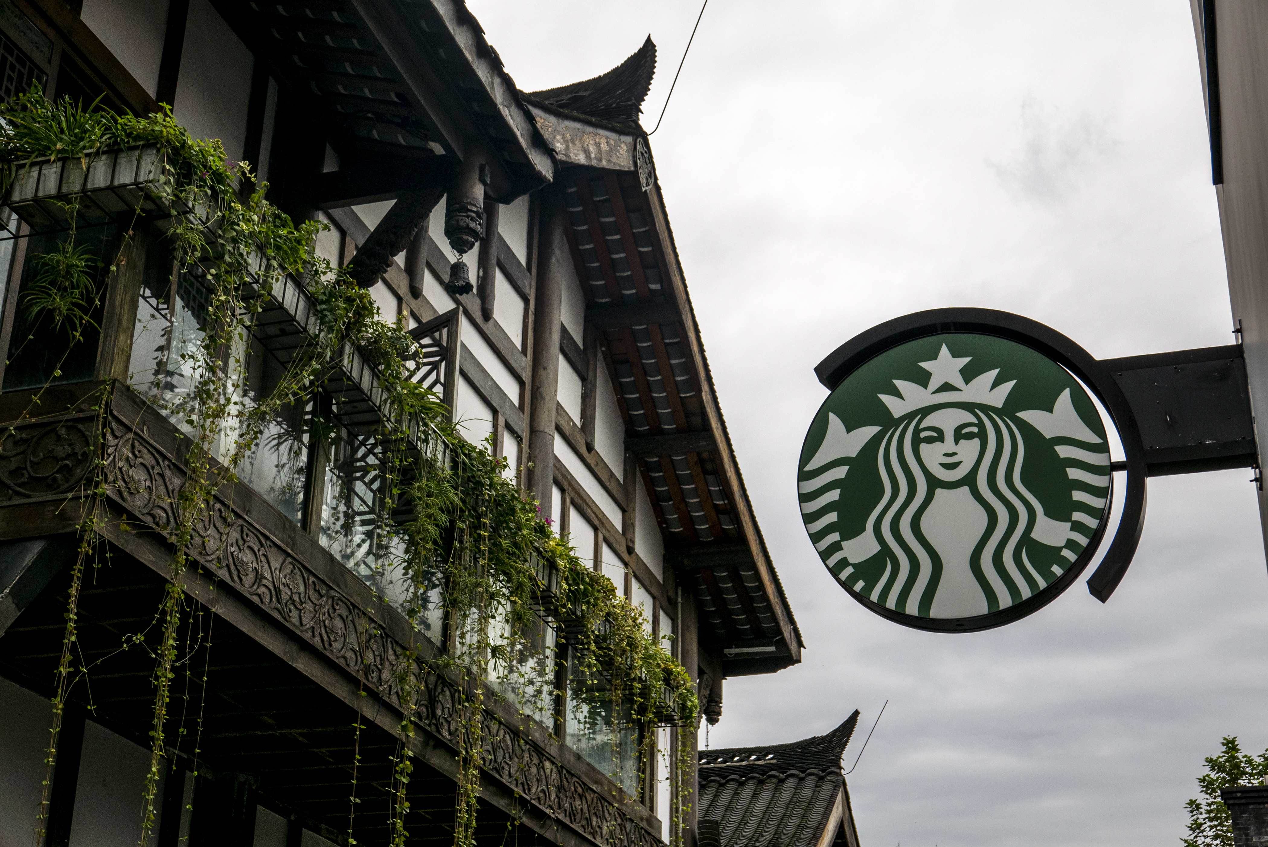 Logo of a Starbucks cafe in Kuan Zhai Alley,  one of the top