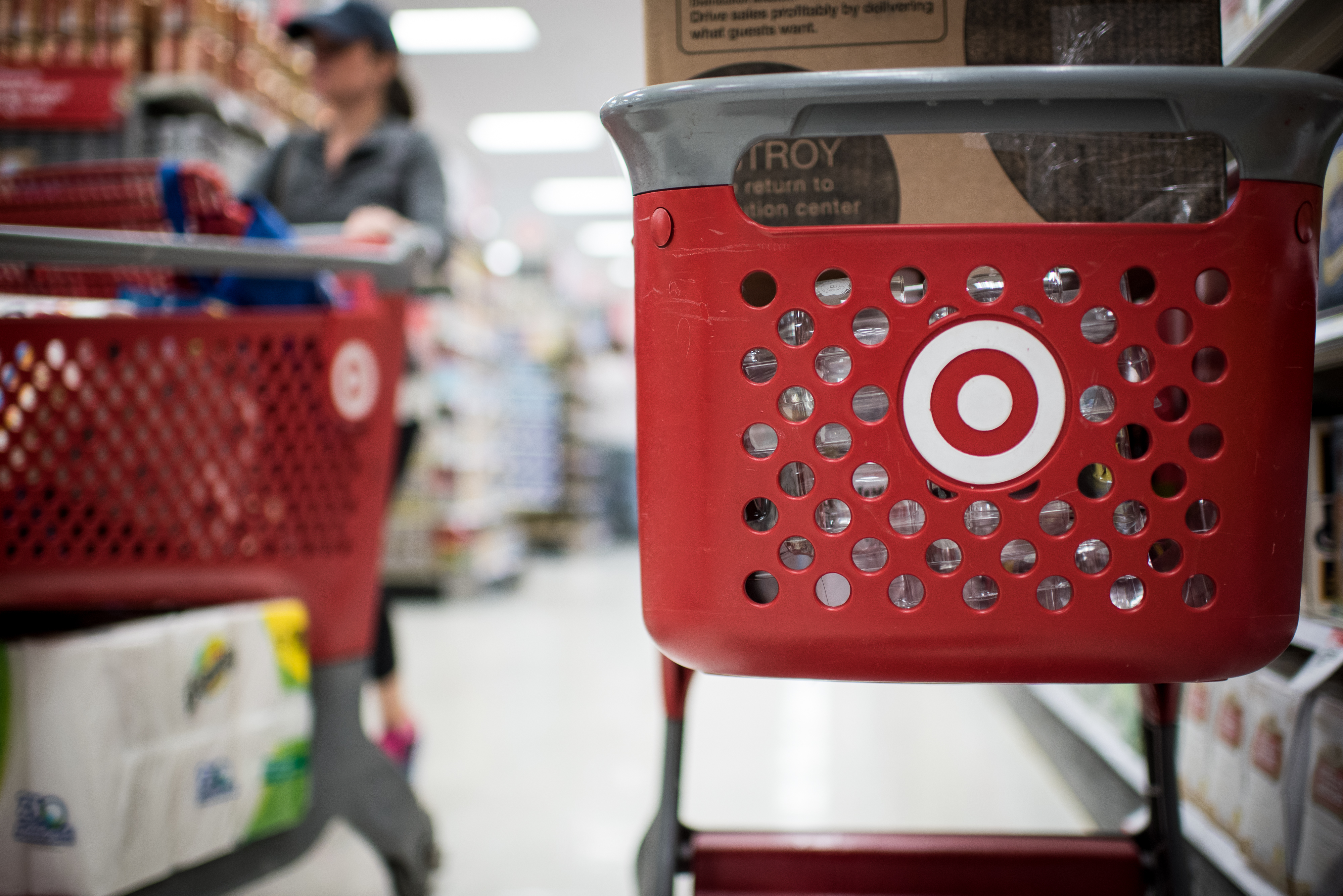 Customers use Target Corp. shopping carts to move products inside a company's store in Chicago, Illinois, U.S., on Monday, May 16, 2016.