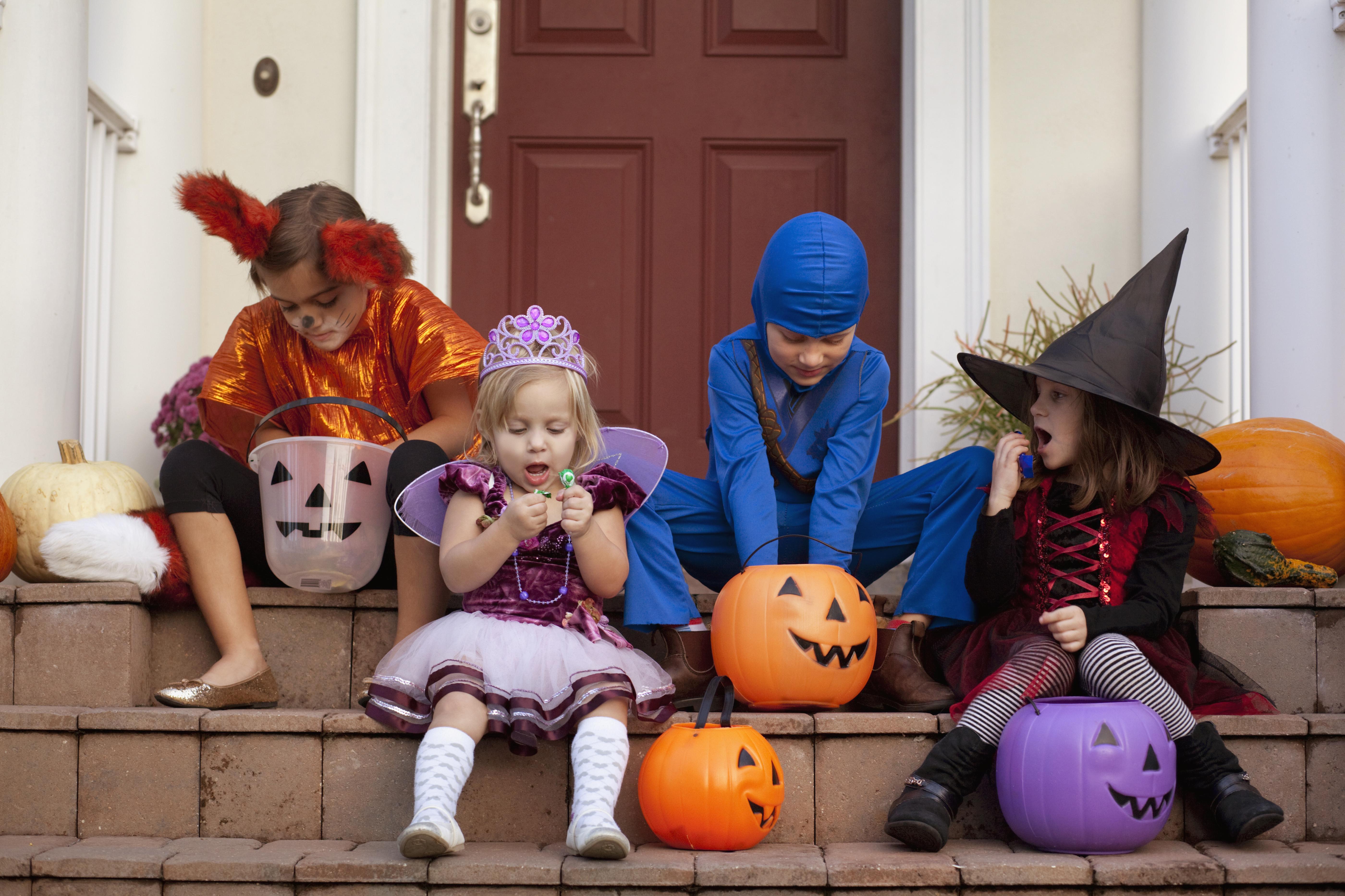 Children enjoying treats on steps