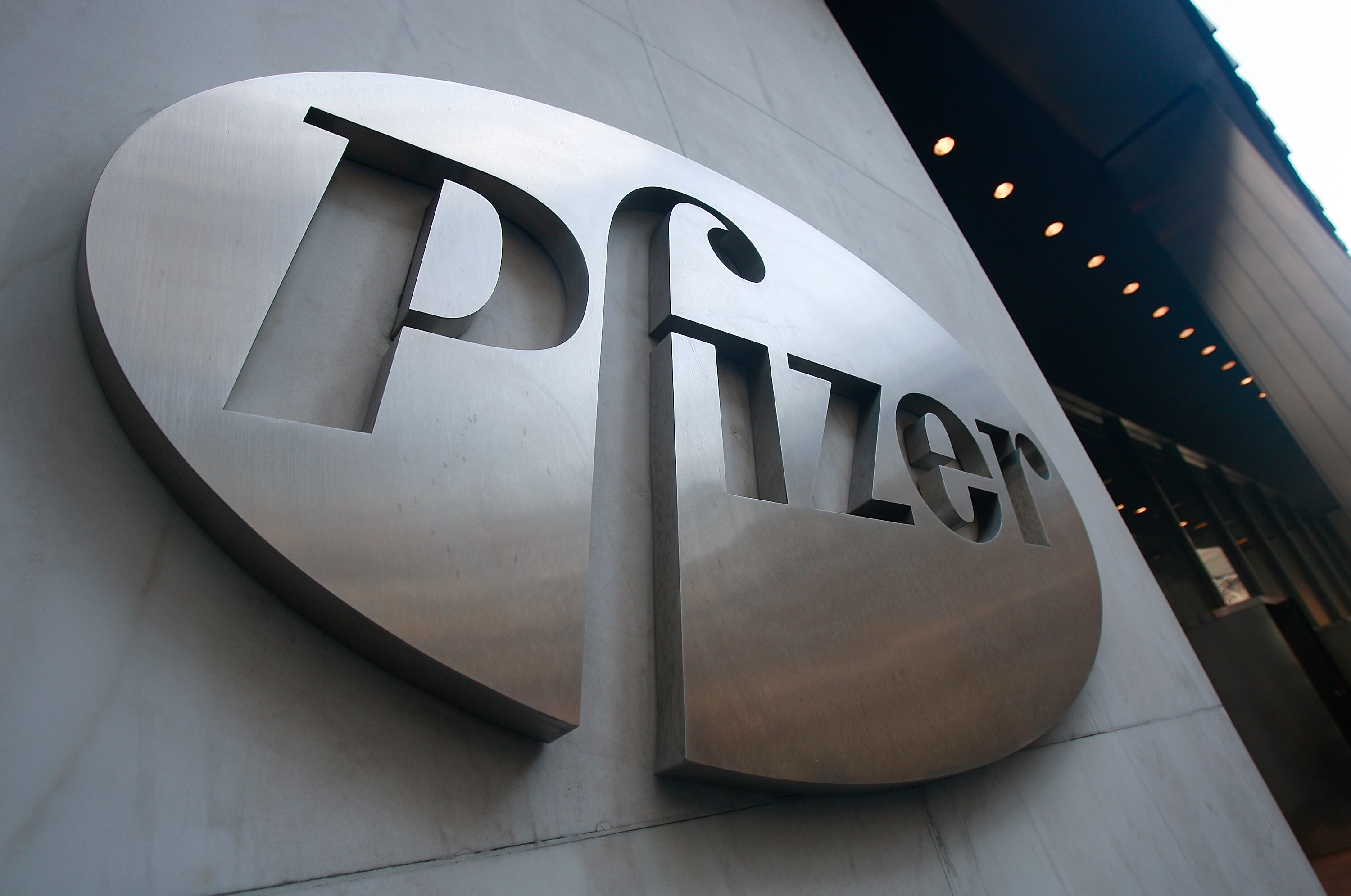 A Pfizer sign hangs on the outside of their headquarters in New York City.
