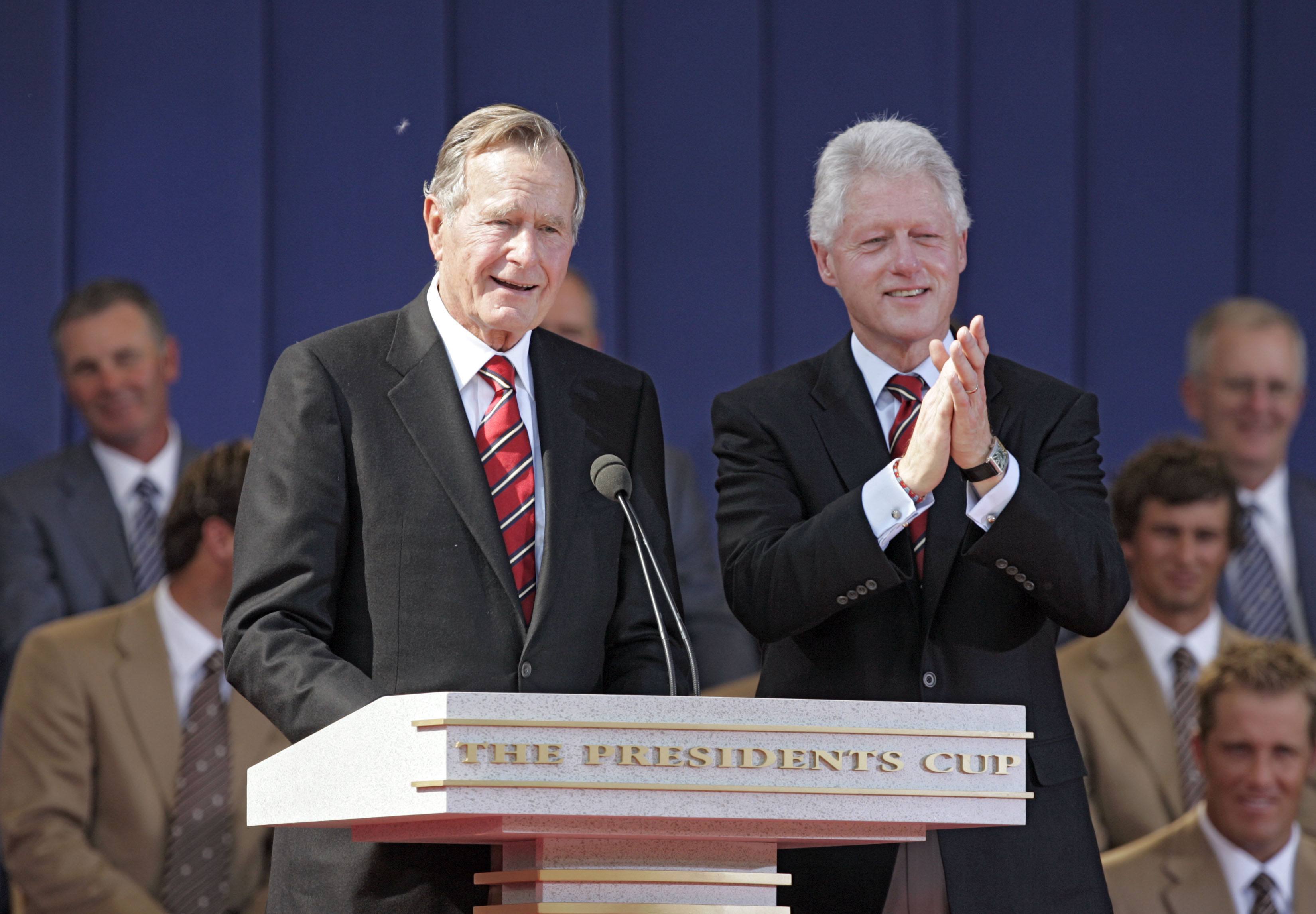 Former United States Presidents George H.W. Bush and Bill Clinton during the opening ceremony of The Presidents Cup at Robert Trent Jones Golf Club in Prince William County, Virginia on September 22, 2005.