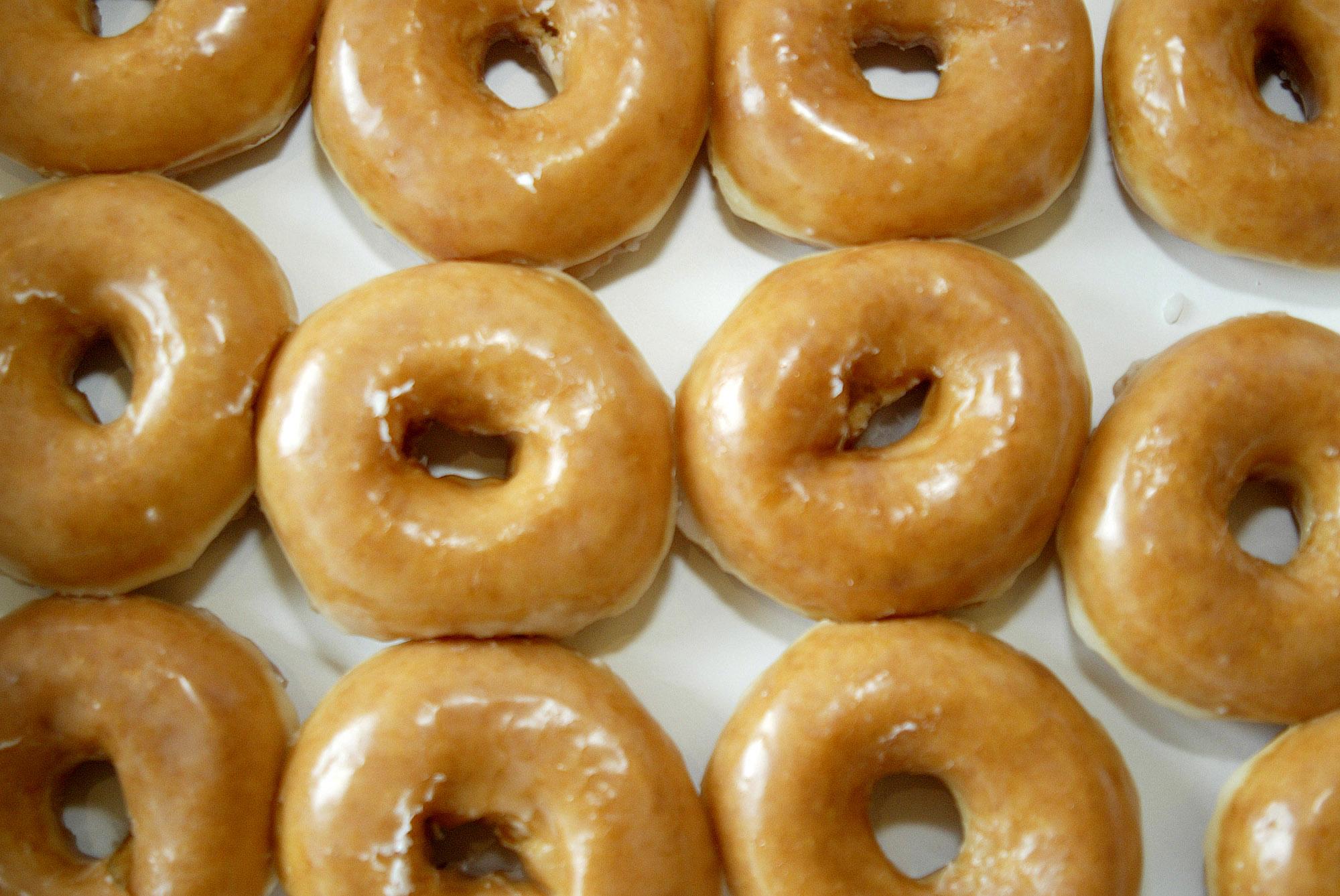 A box of glazed doughnuts is seen at a Krispy Kreme in Charl