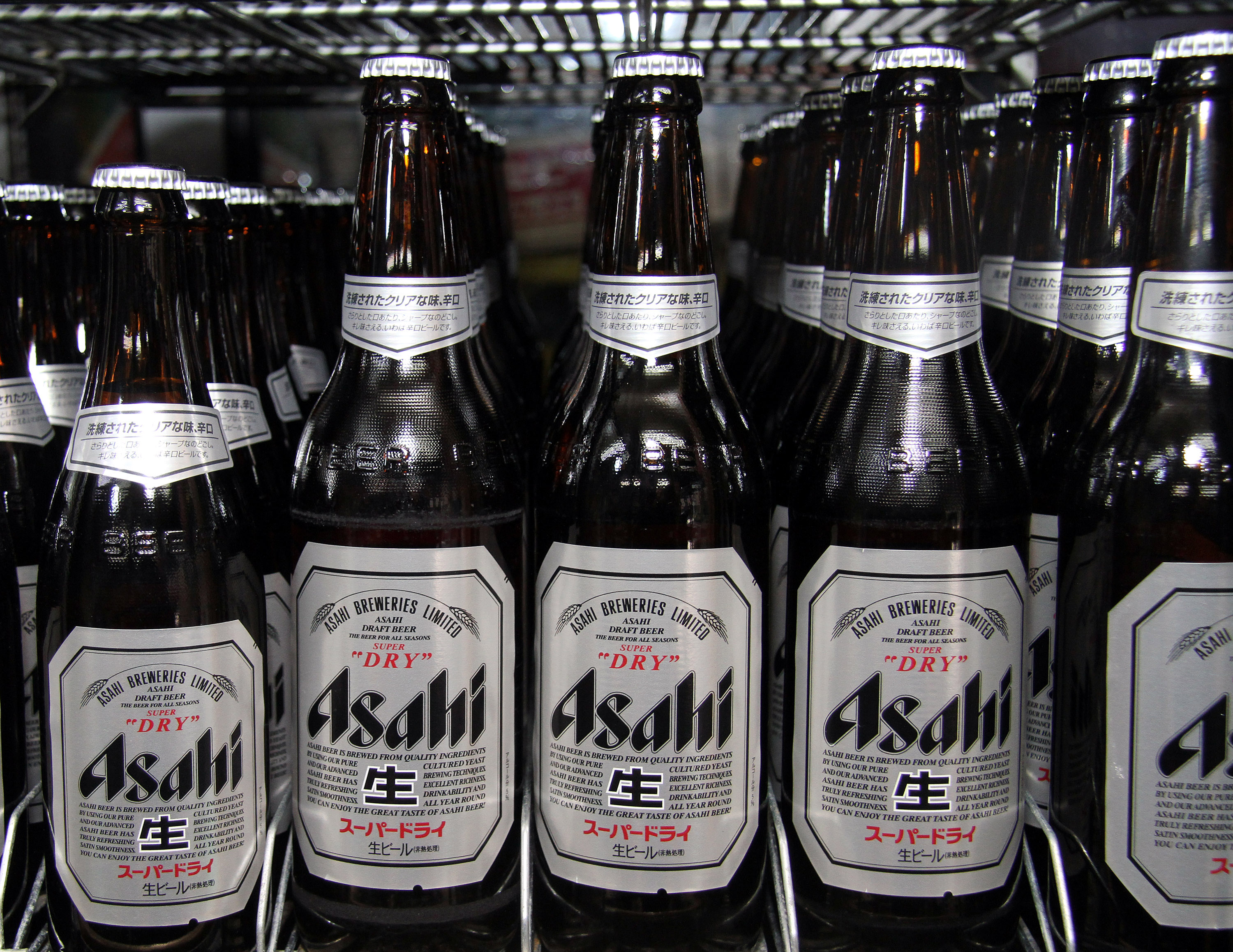 Bottles of Asahi Breweries Ltd.'s Super Dry beer are display
