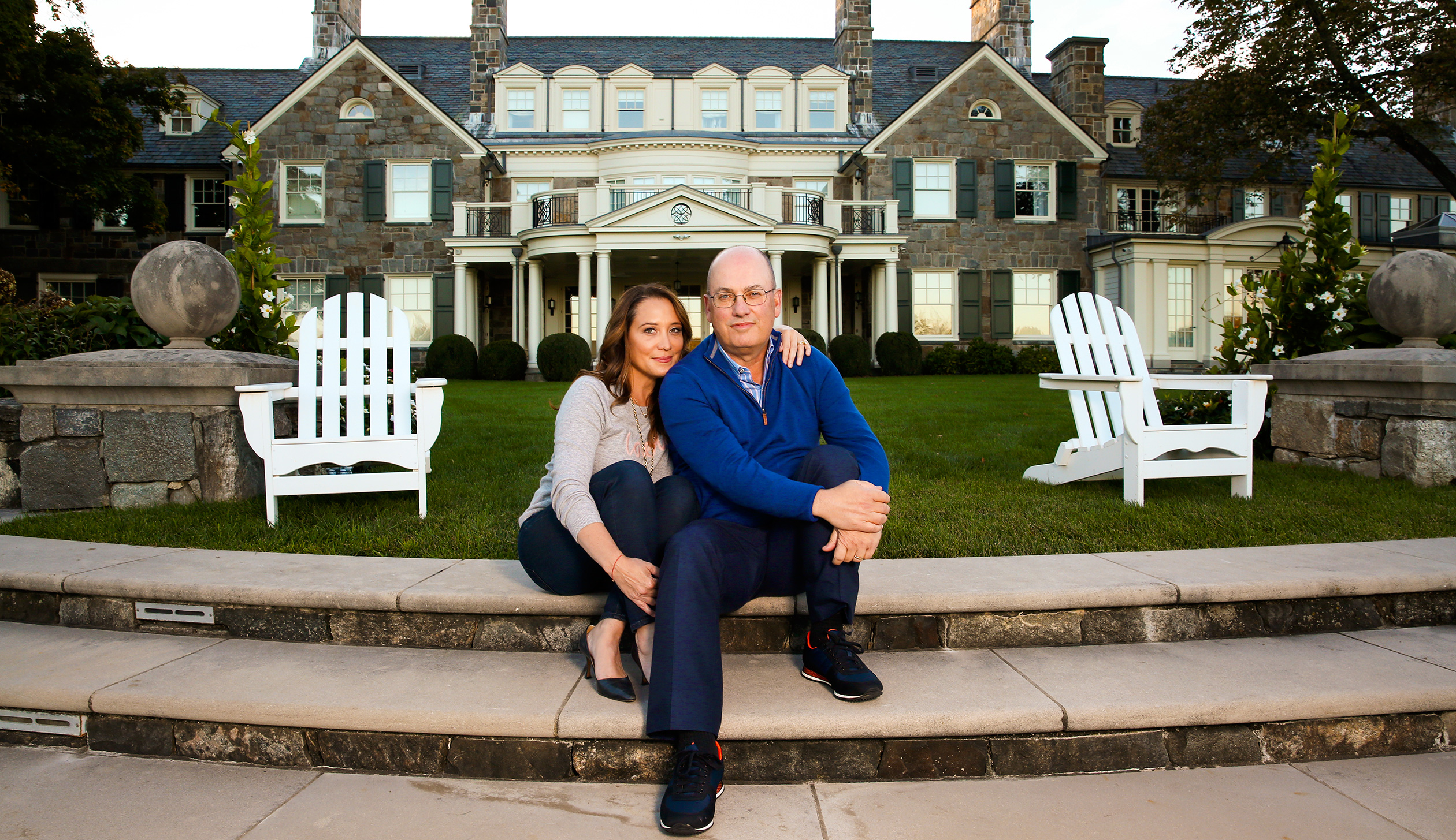 Steve and Alex Cohen in front of their home in Greenwich, Conn. The couple are worth about $13 billion, a fortune largely undented by legal troubles at Cohen's former hedge fund firm.