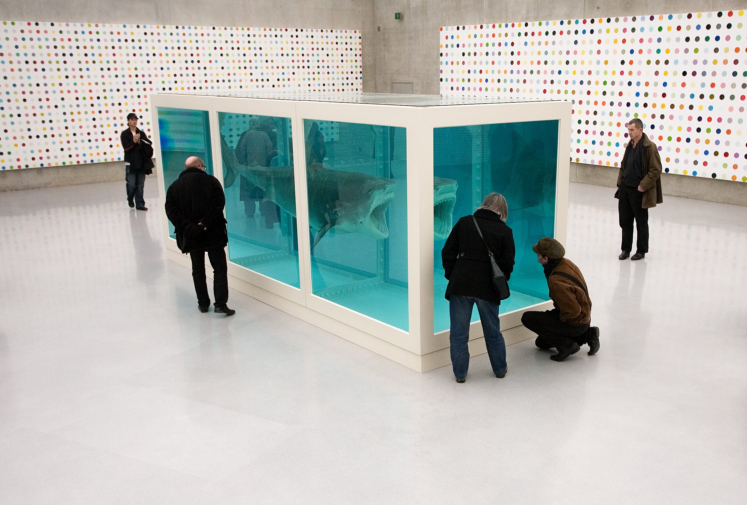 Visitors contemplate a work by British artist Hirst at the Kunsthaus in Bregenz