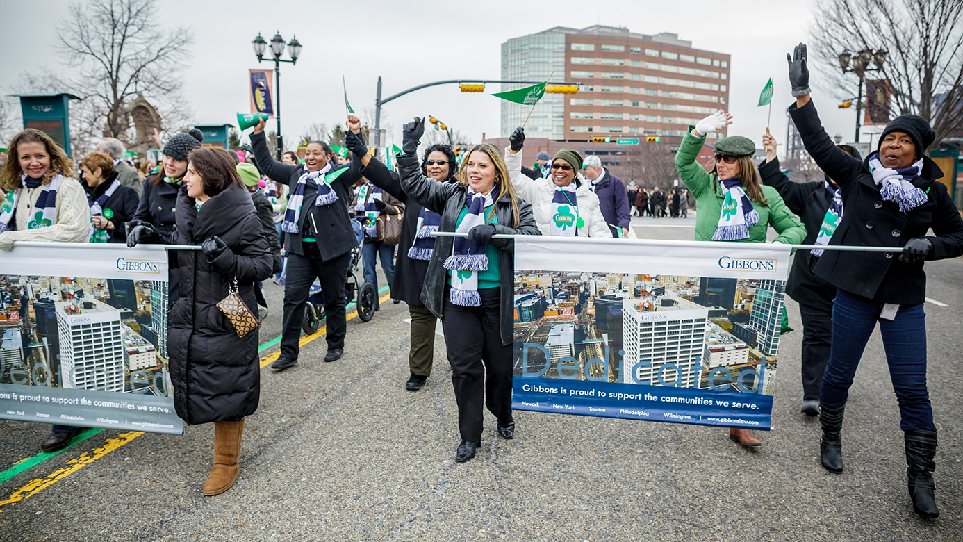 """2013 Newark St. Patrick's Day Parade. Grand Marshal: Patrick C. Dunican Jr., Esq. - Chairman and Managing Director, Gibbons P.C.. Deputy Grand Marshal: DSFC Eileen P. Gilleece - New Jersey State PoliceParade Dedication: ✝Terence """"Terry"""" PellegrinoProceeding from the Prudential Center to Gateway Center, NJPAC, Military Park, St. Patrick's Pro-Cathedral, and Washington Park"""