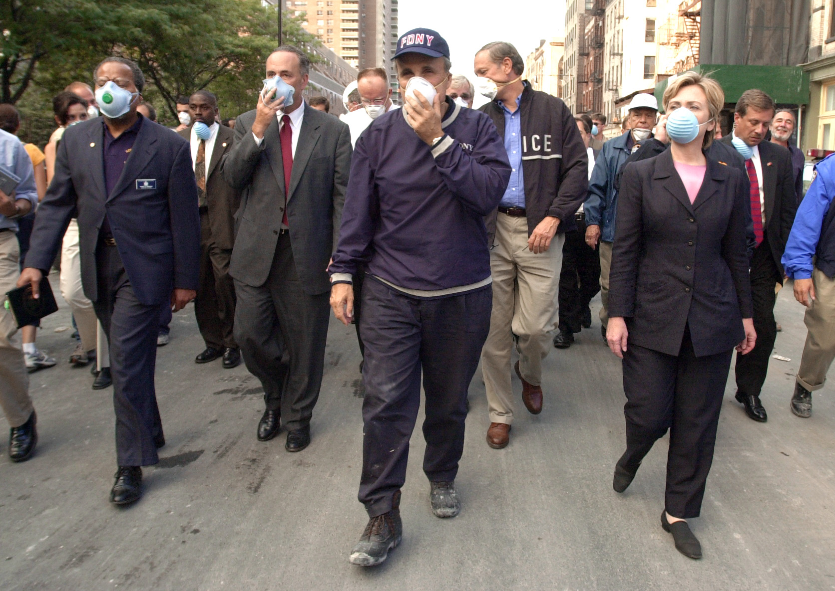 New York City Mayor Rudolph Giuliani (C) leads US