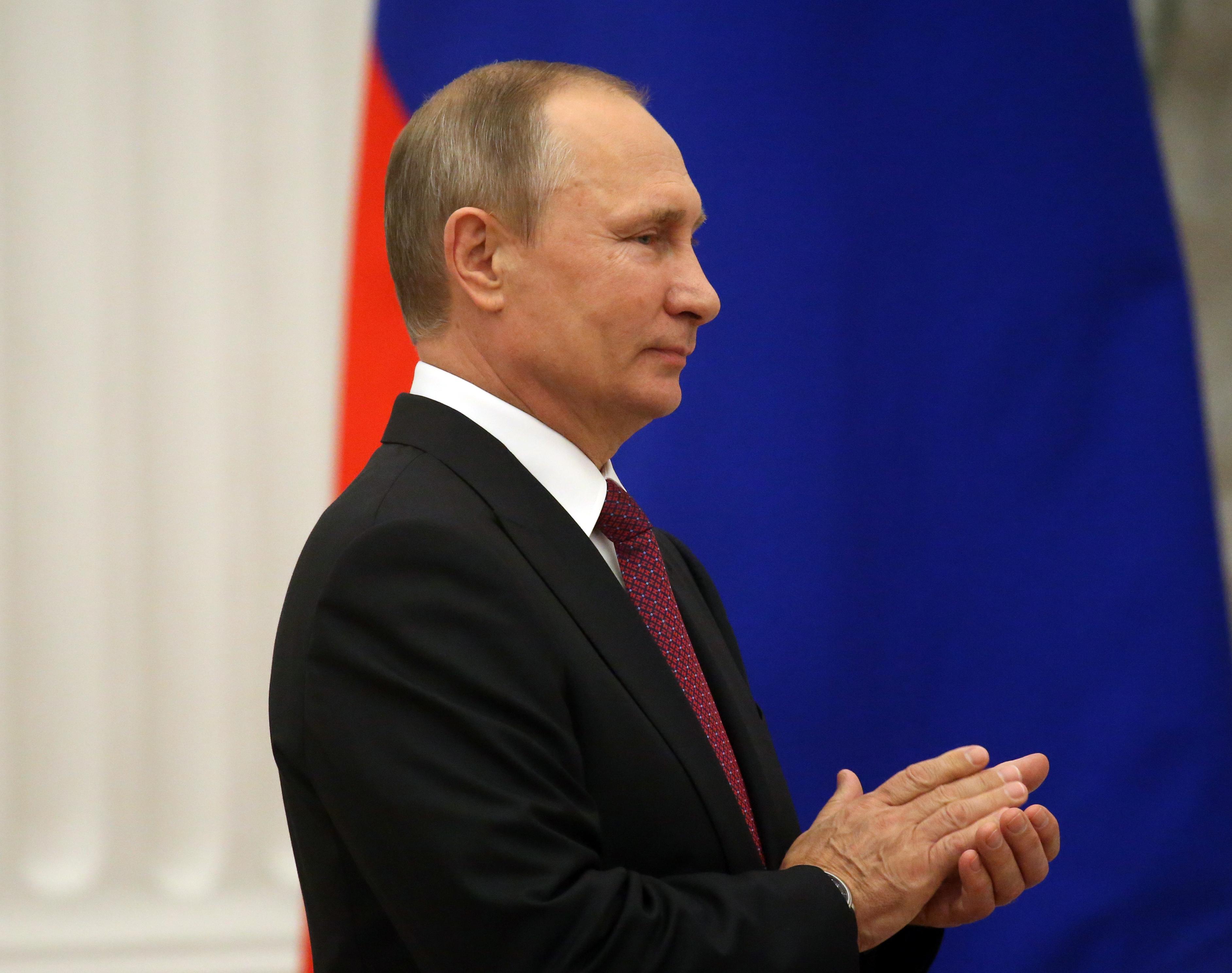 Russian President Vladimir Putin attends the awarding ceremony at the Kremlin