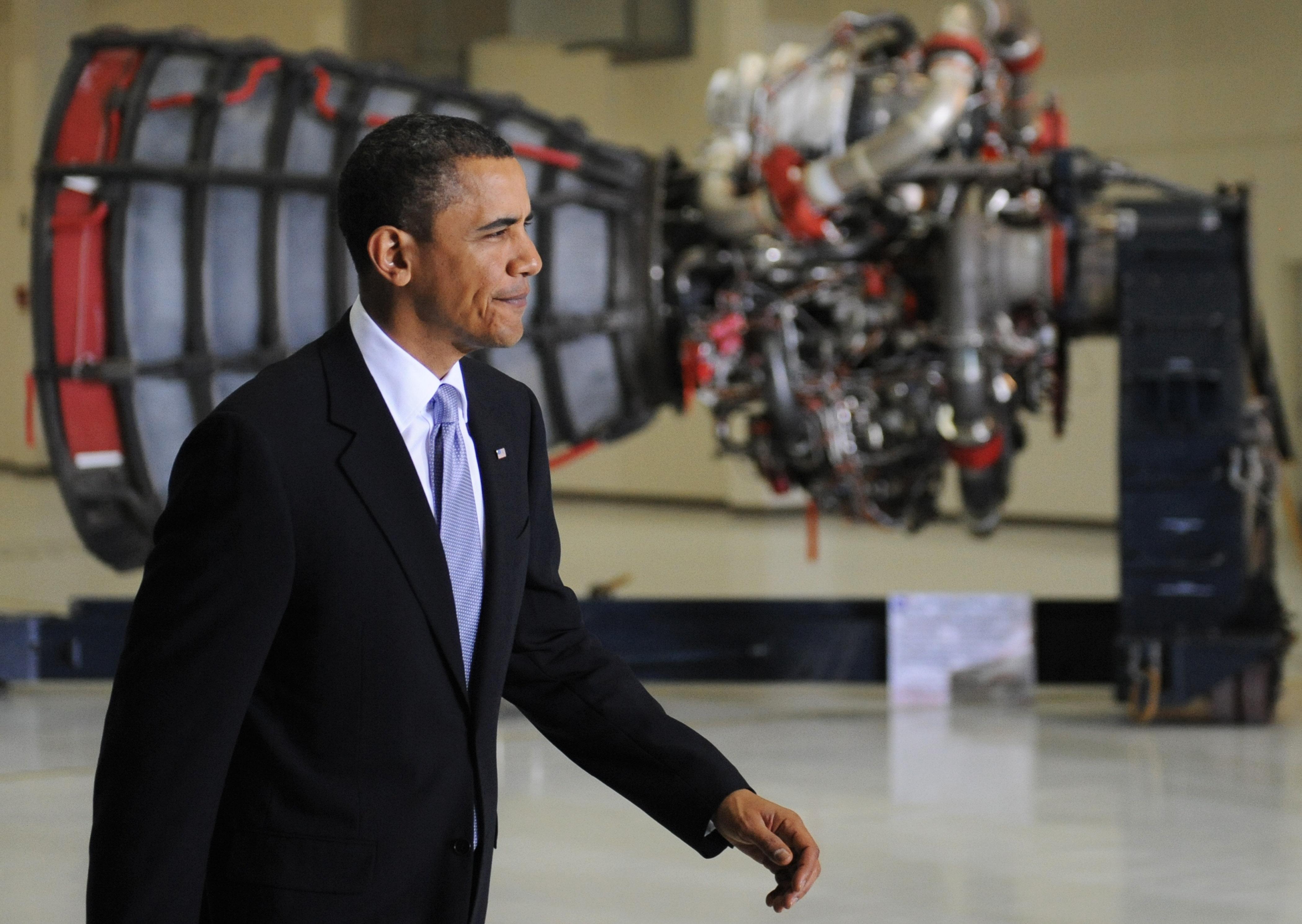US President Barack Obama walks past a m
