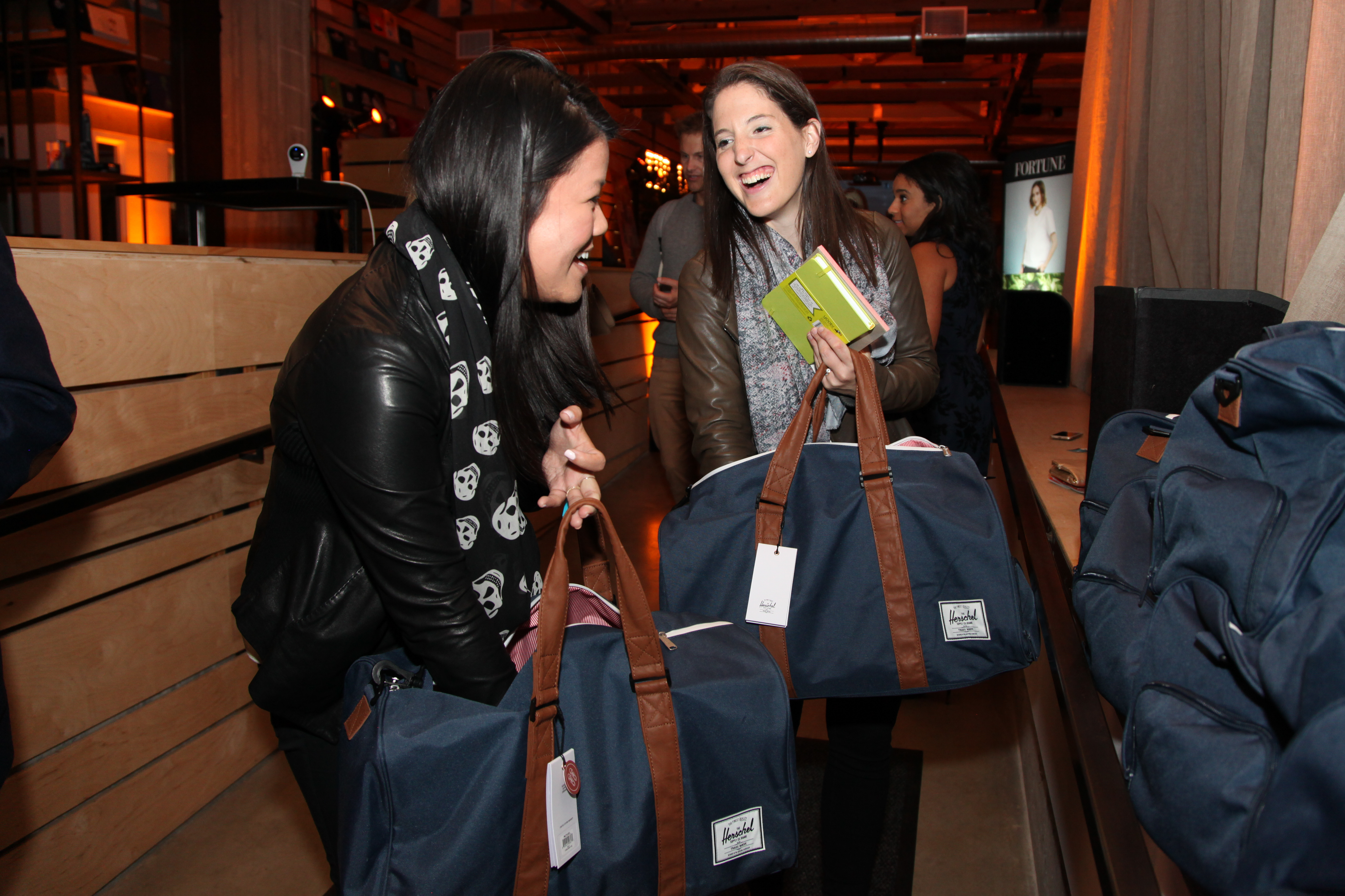 Rachel Holt, right, Head of North American Operations at Uber and 2016 honoree on Fortune's 40 Under 40 list, and MoMo Zhou, Corporate Communications at Uber, checks out the party gift bag contents.