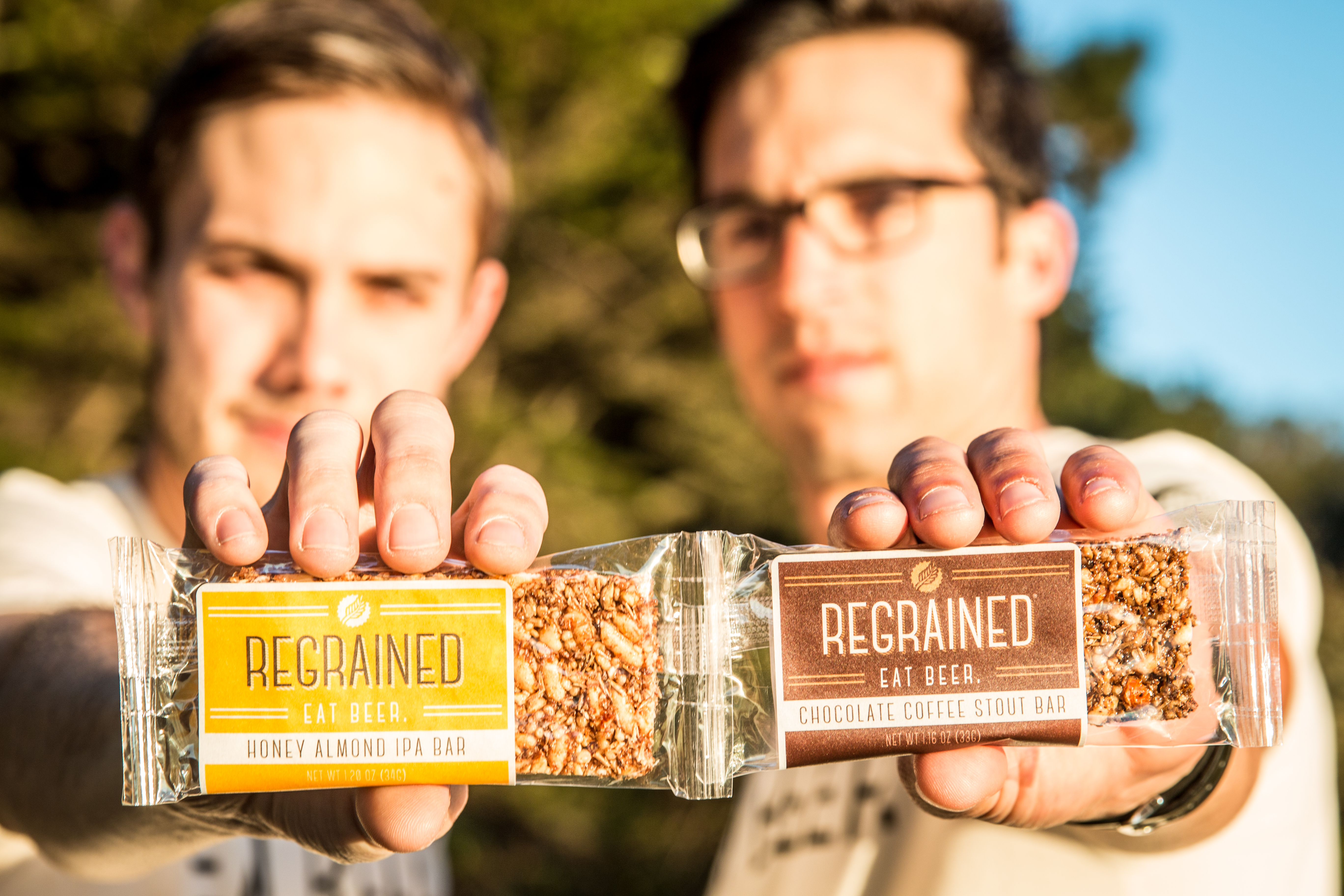 ReGrained founders Dan Kurzrock and Jordan Schwartz hold up their granola bars, which are made from used beer grain.