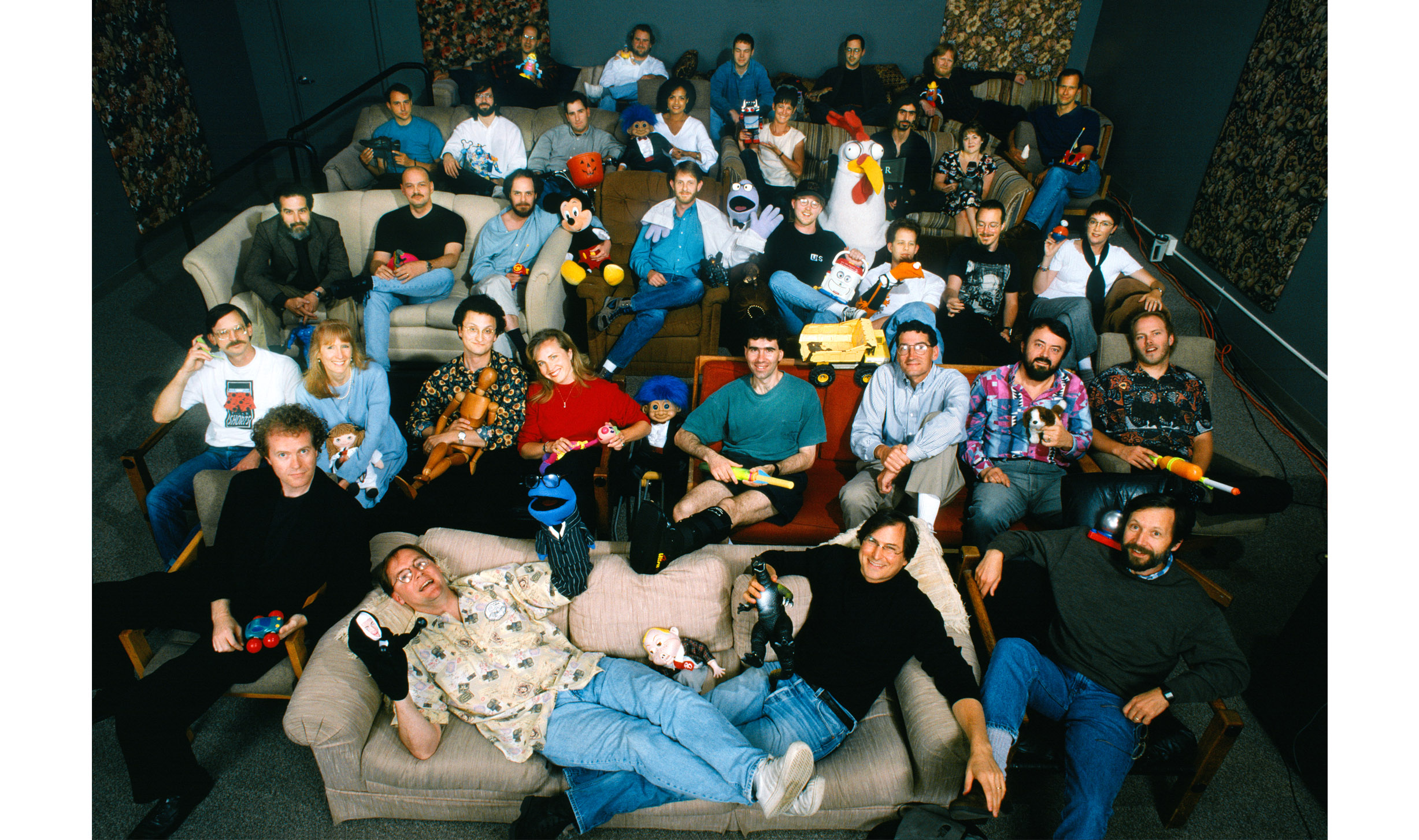 """A group of Pixarians shot for a 1995 Fortune feature, """"Steve Jobs' Amazing Movie Adventure."""" Levy, his leg in a black cast, is in the second row, behind Jobs and Lasseter."""
