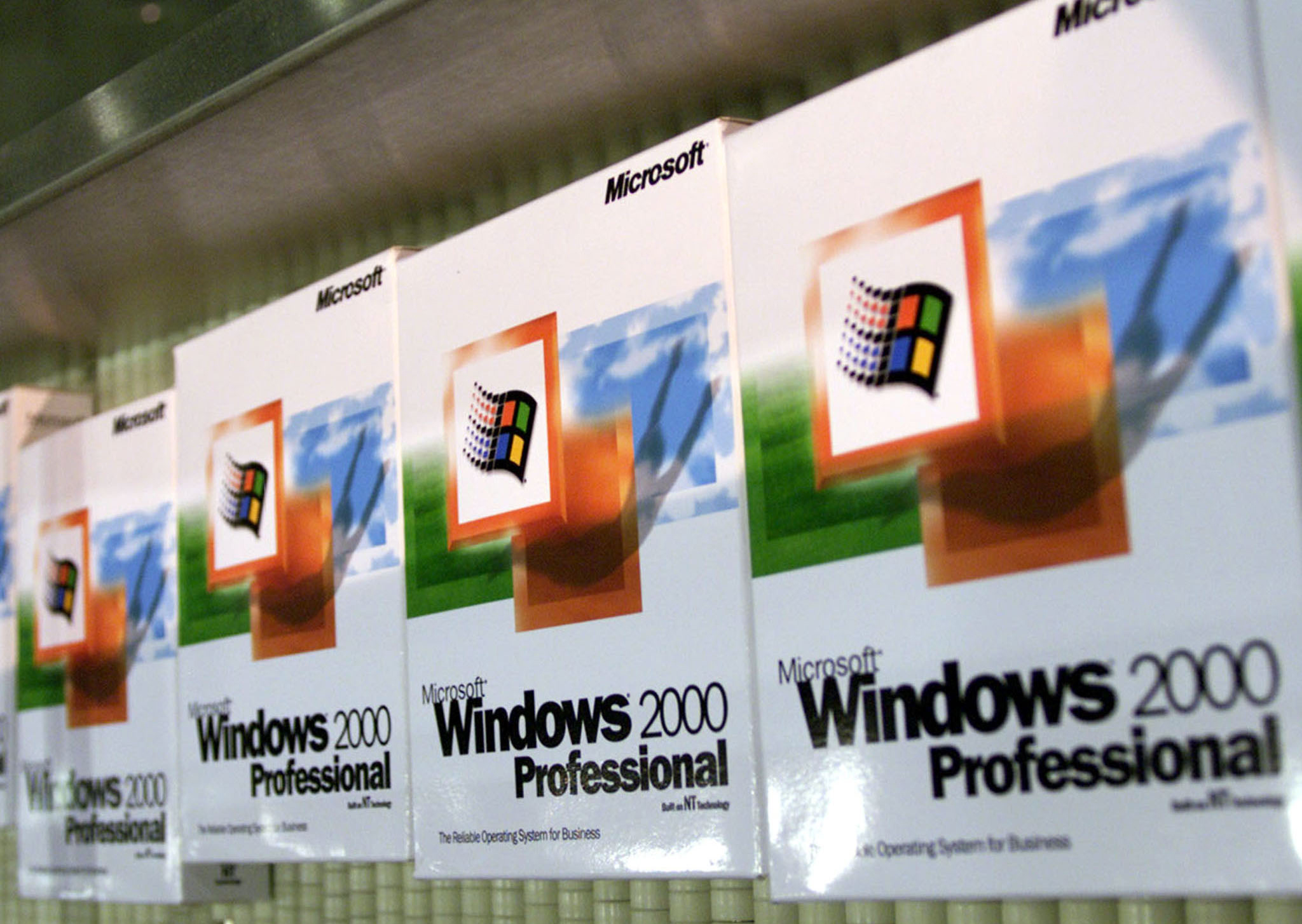 The First Copies Of Microsoft's Windows 2000 Roll Out On An Assembley Line