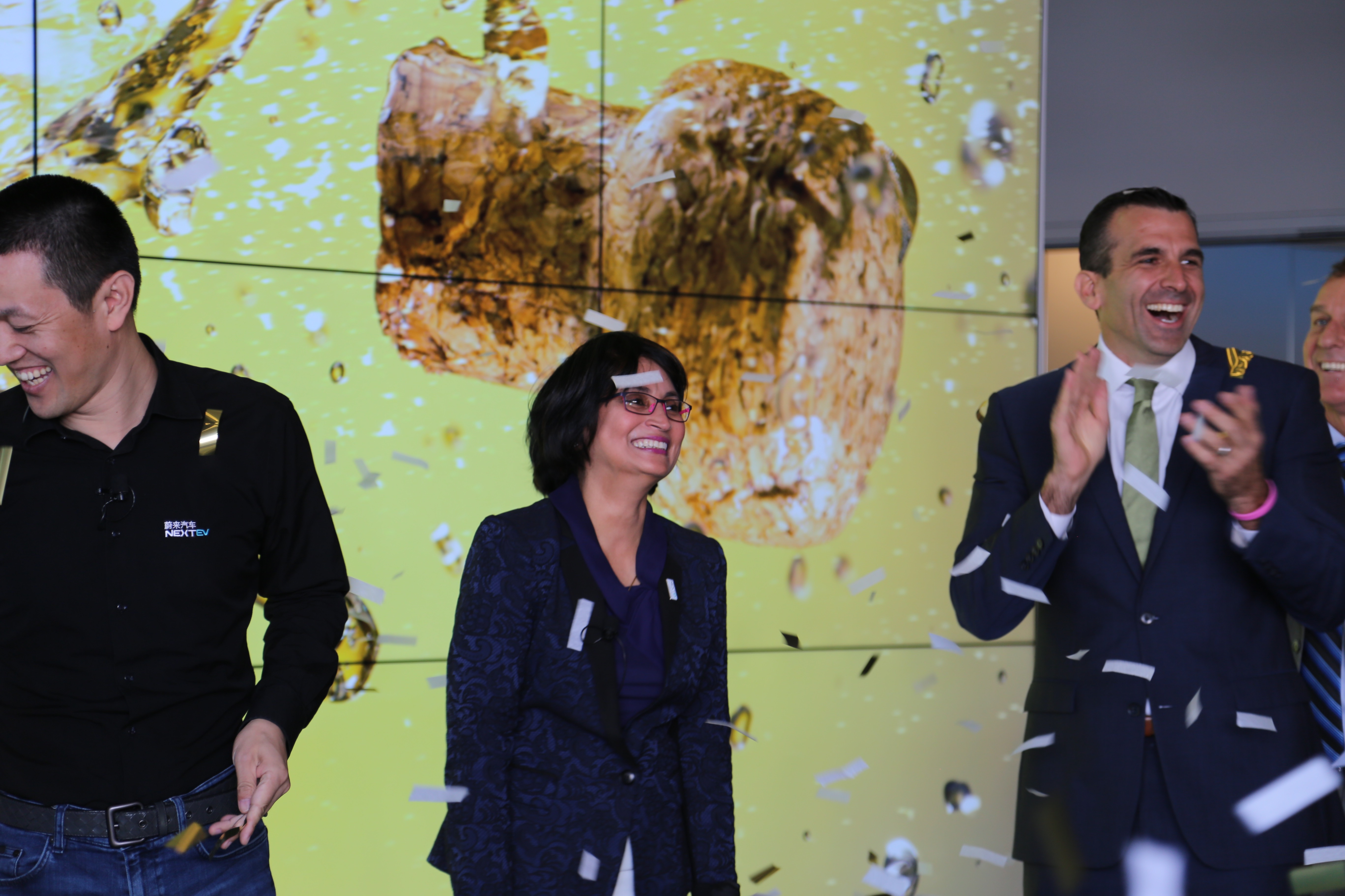 NextEV's grand opening in San Jose, Calif, from left to right, Chairman William Li, U.S. CEO Padmasree Warrior and San Jose Mayor Sam Liccardo.