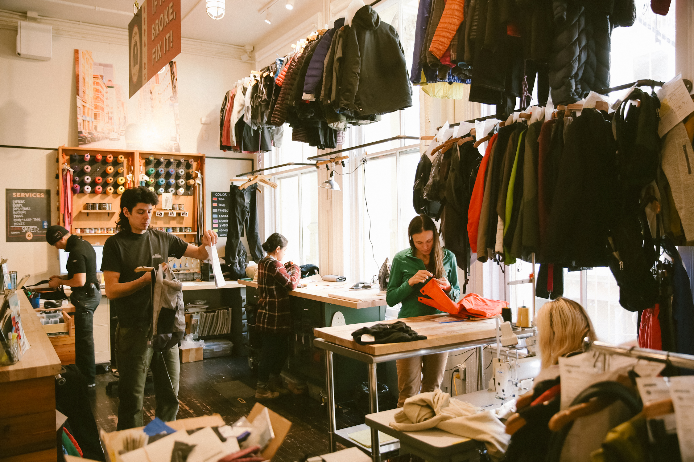SOHO Patagonia Retail Store Worn Wear Repair Center. All models are Patagonia employees.