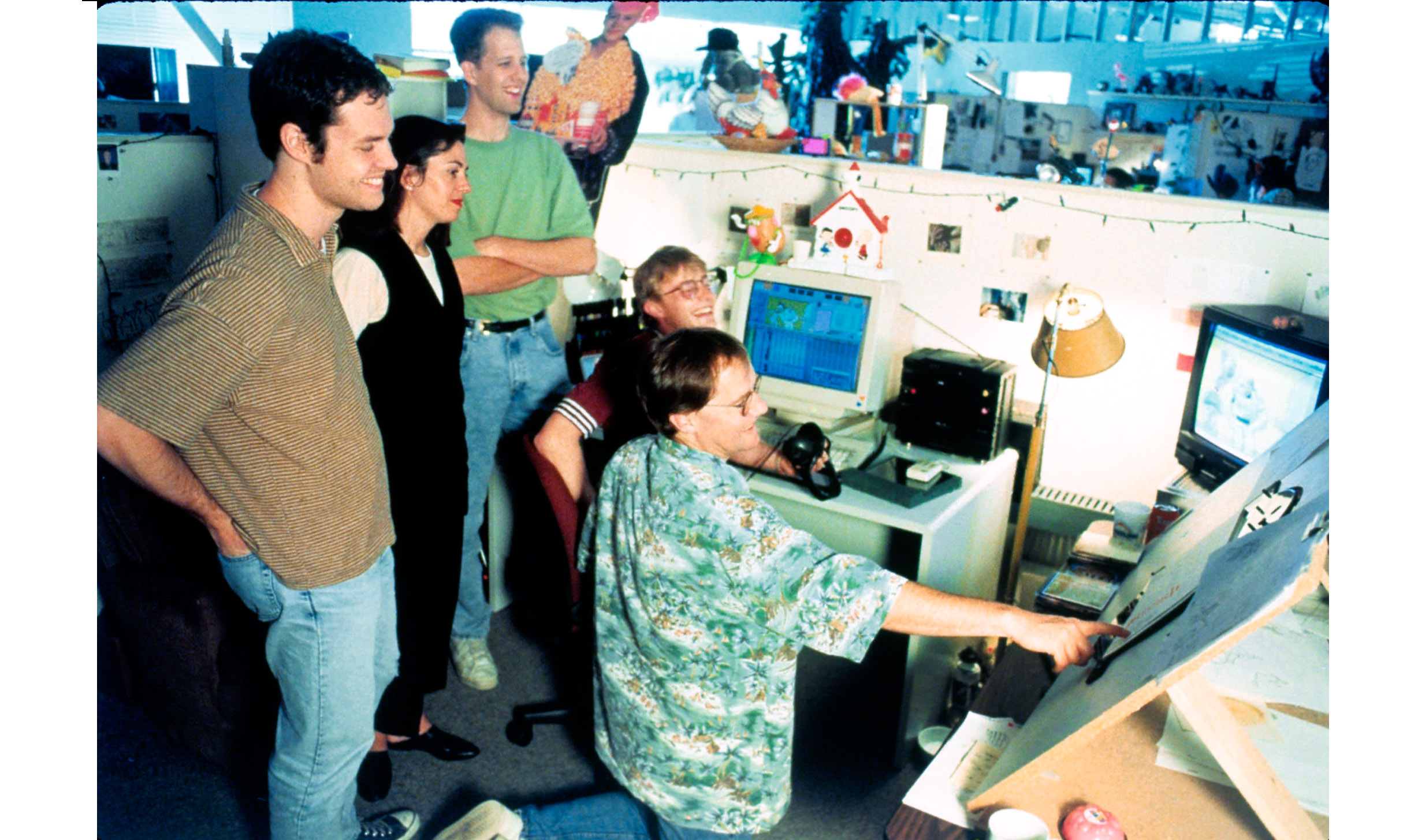 The Pixar crew working on 'Toy Story' with Lasseter, kneeling, in 1995.