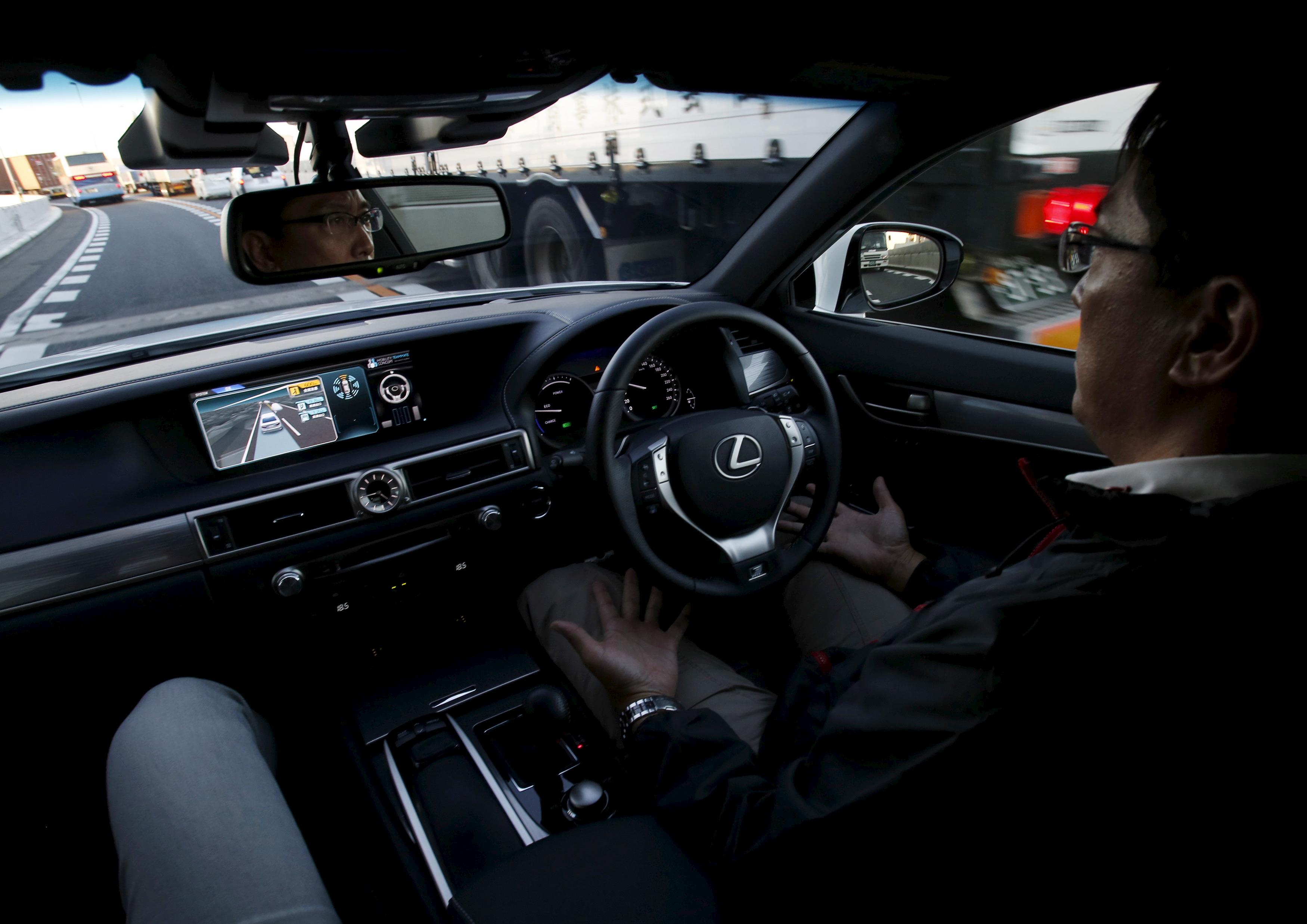 """A staff member of Toyota Motor Corp drives its self-driving technology """"Mobility Teammate Concept"""" prototype car hands-free on the Metropolitan Expressway during the Toyota Advanced Technologies media preview in Tokyo"""