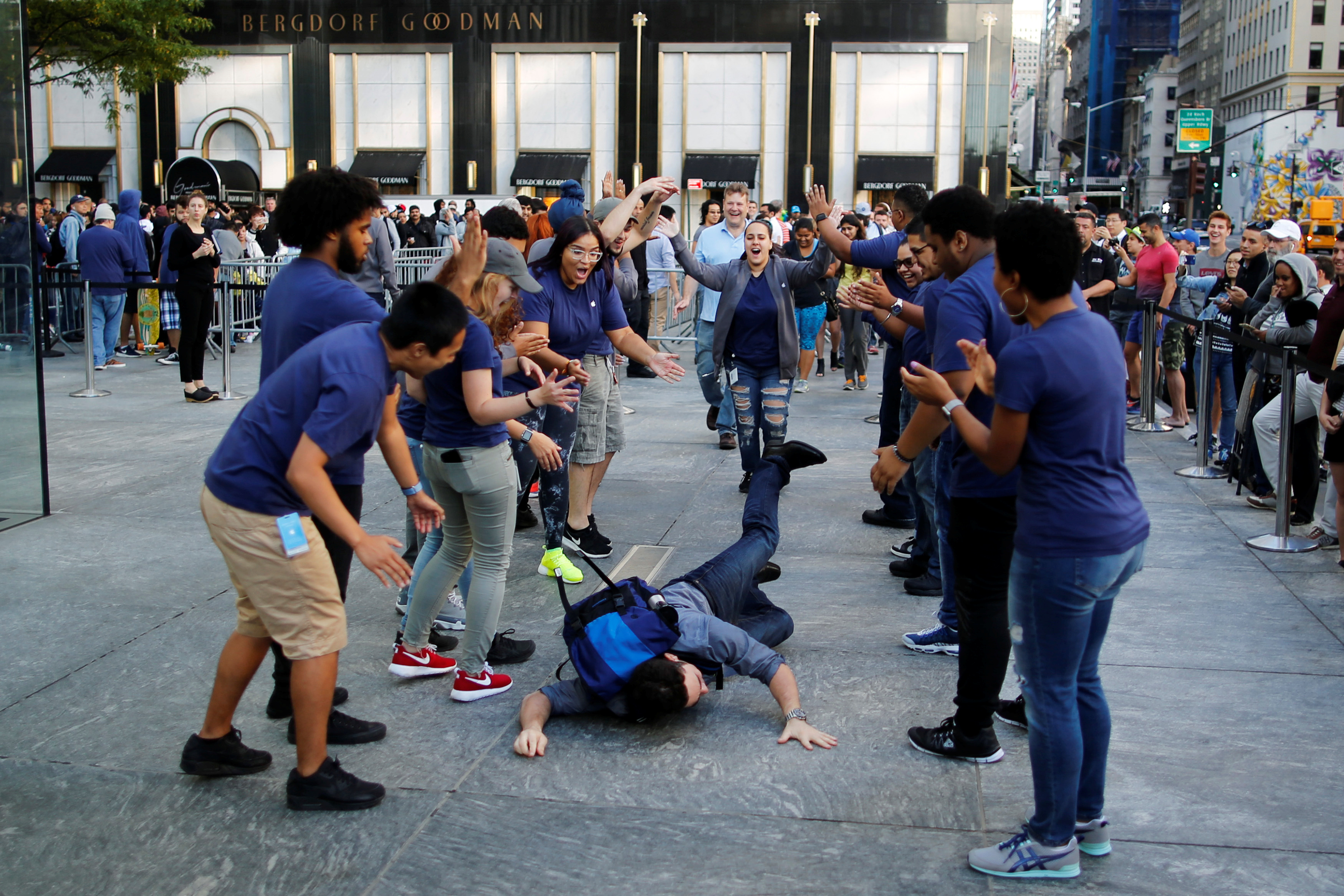 A customer falls down before going into the Apple Inc. store for buying the iPhone 7 smartphone in New York, U.S.