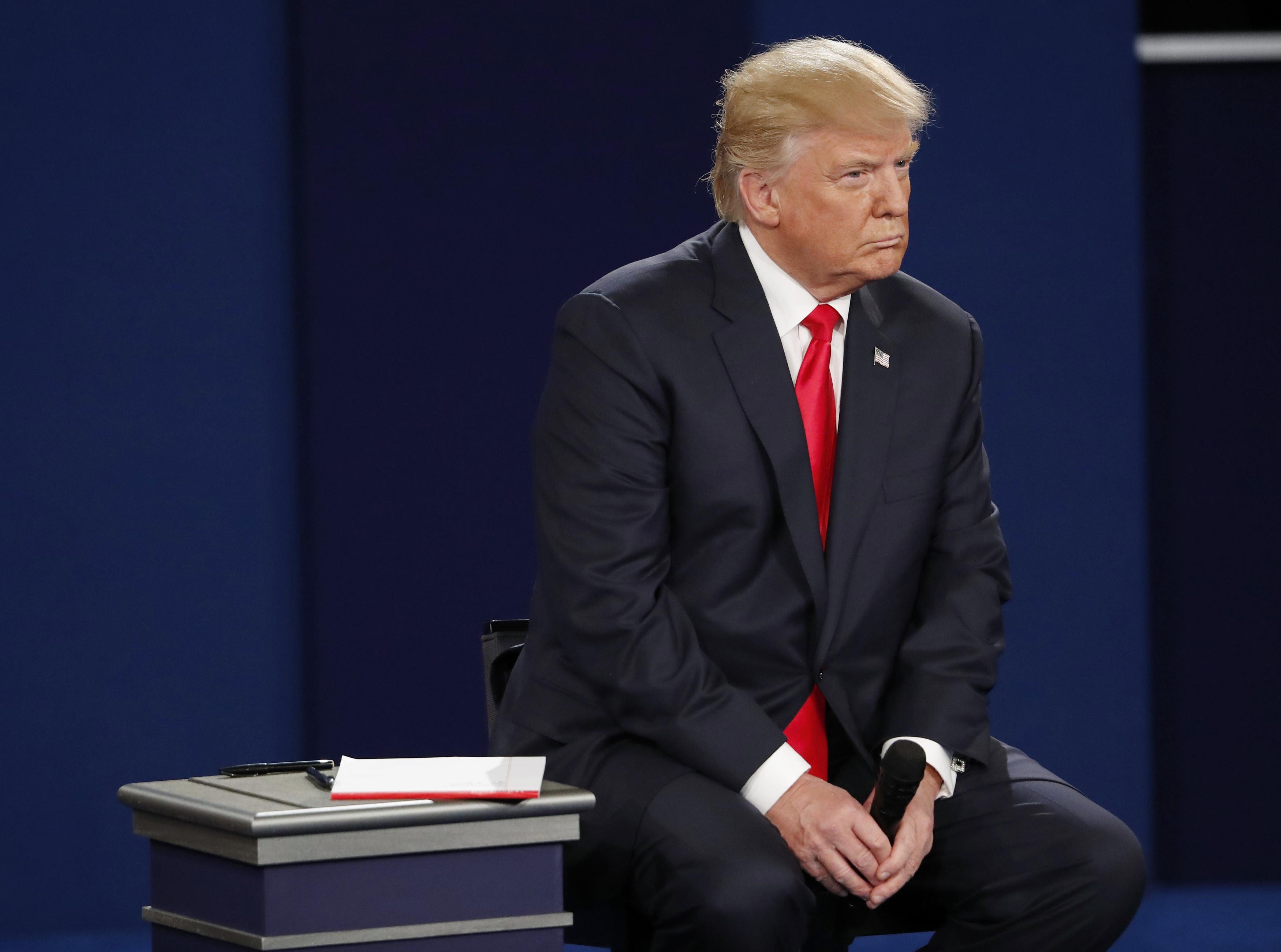 Republican U.S. presidential nominee Donald Trump listens during the second U.S. presidential town hall debate between Trump and Democratic U.S. presidential nominee Hillary Clinton at Washington University in St. Louis