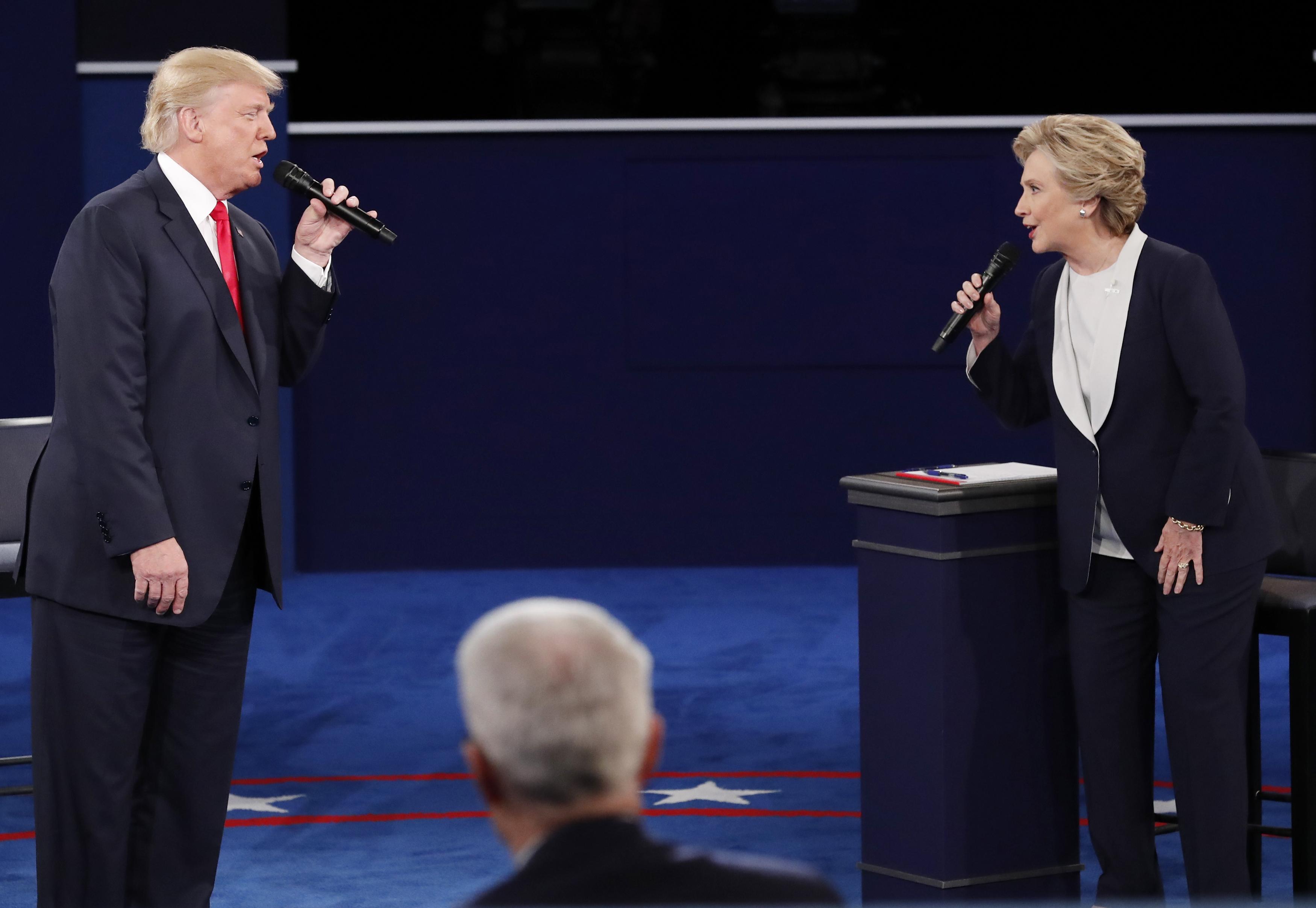 Republican U.S. presidential nominee Donald Trump and Democratic U.S. presidential nominee Hillary Clinton speak during their presidential town hall debate at Washington University in St. Louis