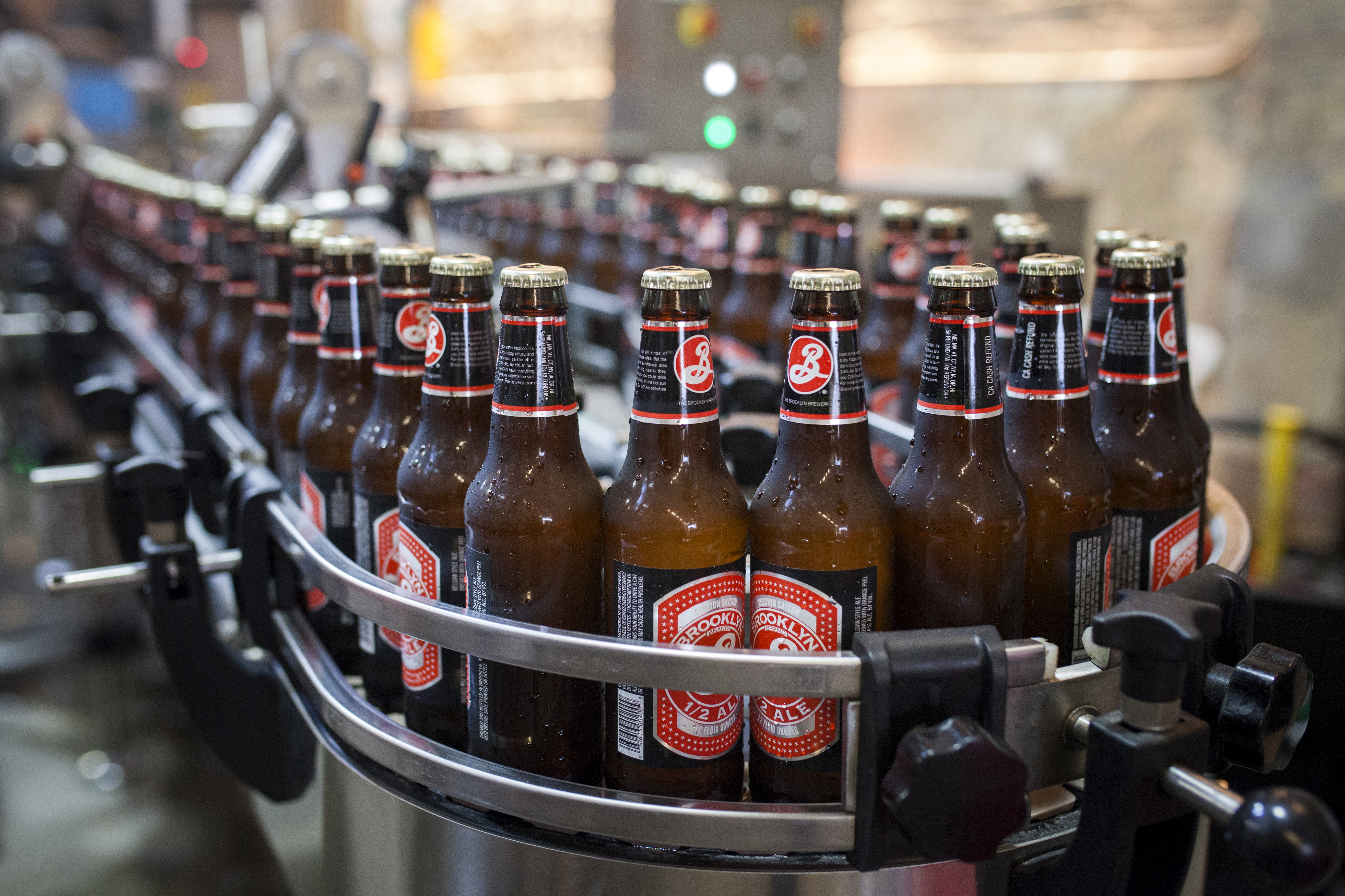Bottled beers move down a bottling line at the Brooklyn Brewery in New York