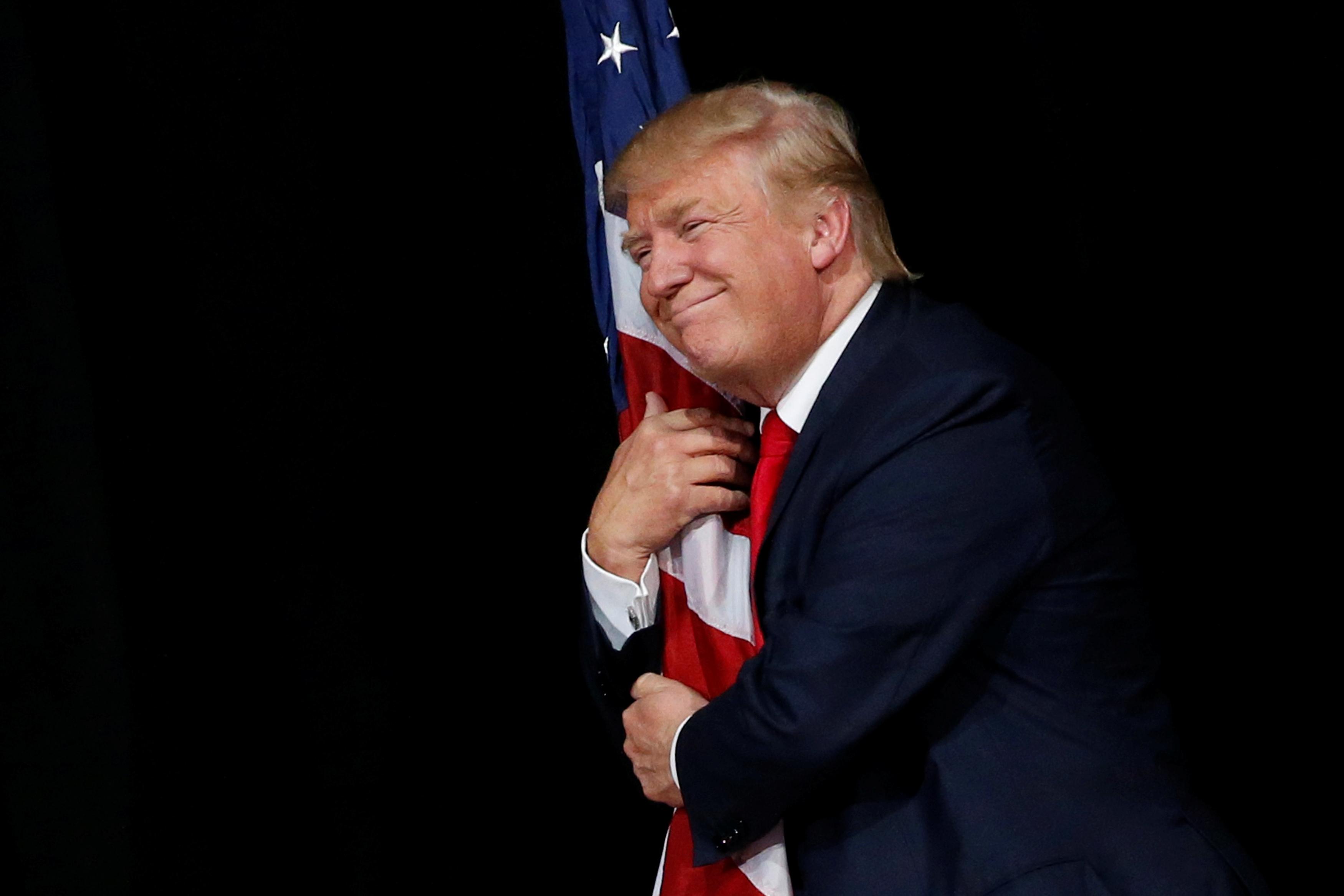 Image result for Trump hugging flag