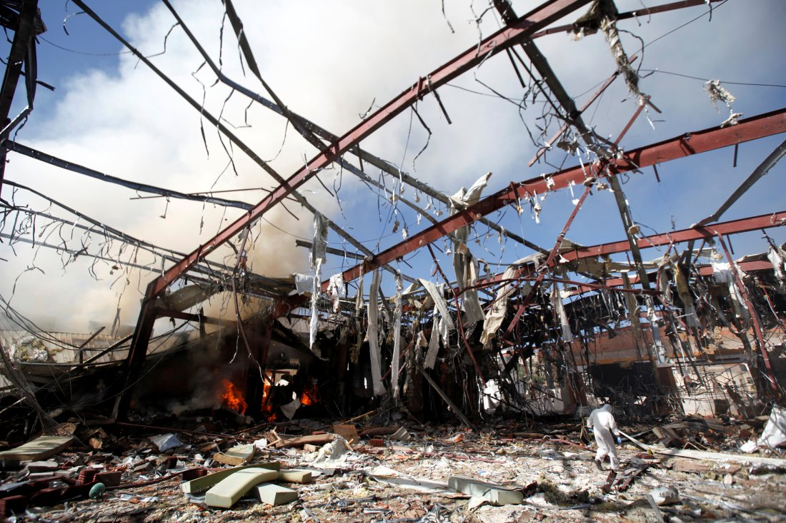Smoke rises from the community hall where Saudi-led warplanes struck a funeral in Sanaa, the capital of Yemen