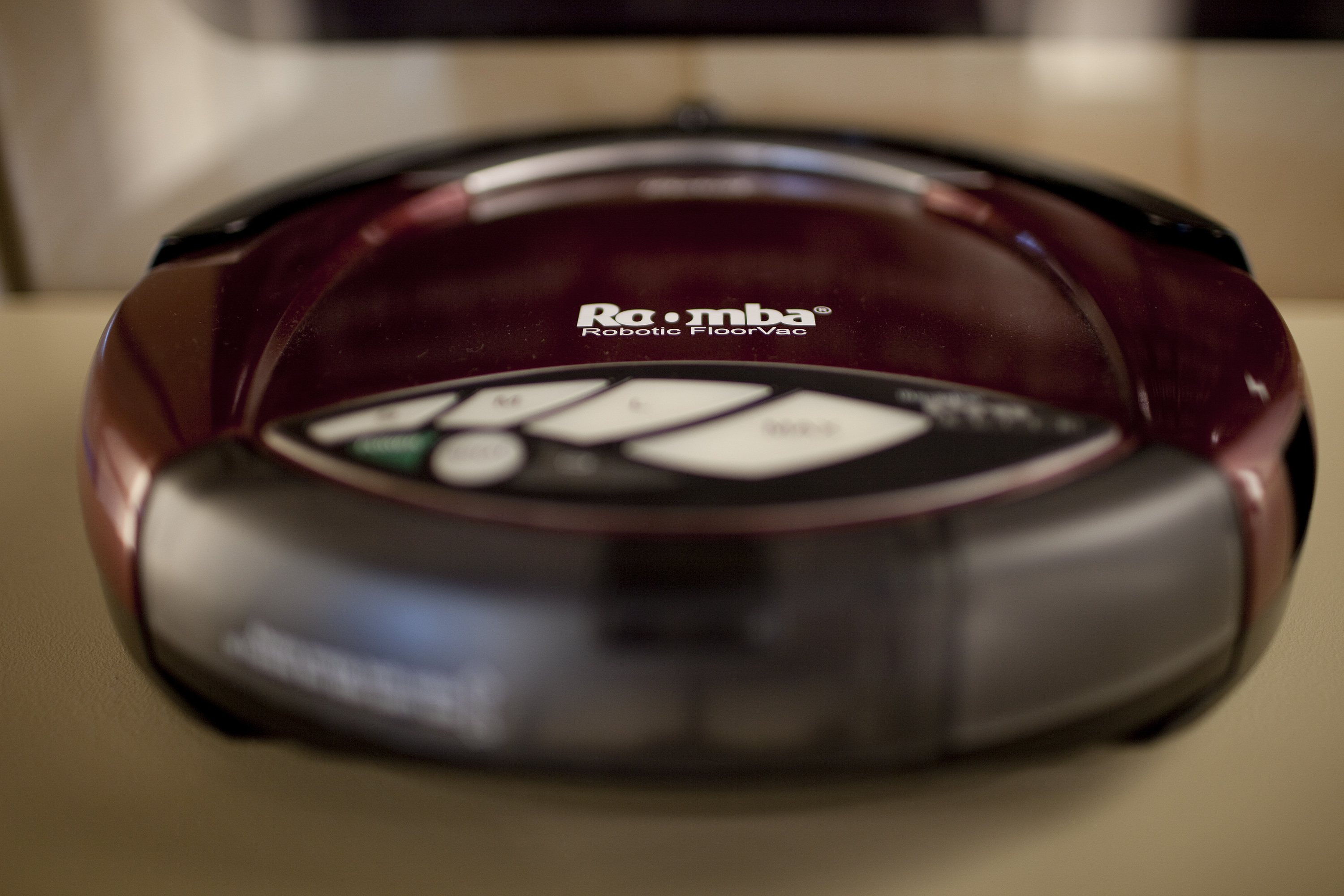 A vacuuming Roomba model robot is displayed at iRobot Corp. headquarters in Massachusetts.