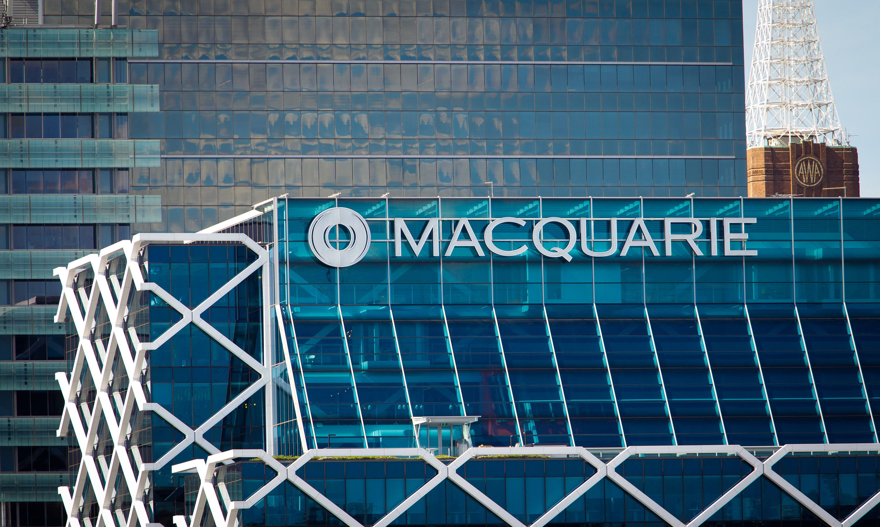 Macquarie Relies on Cost Cuts for Recovery After Profit Sinks