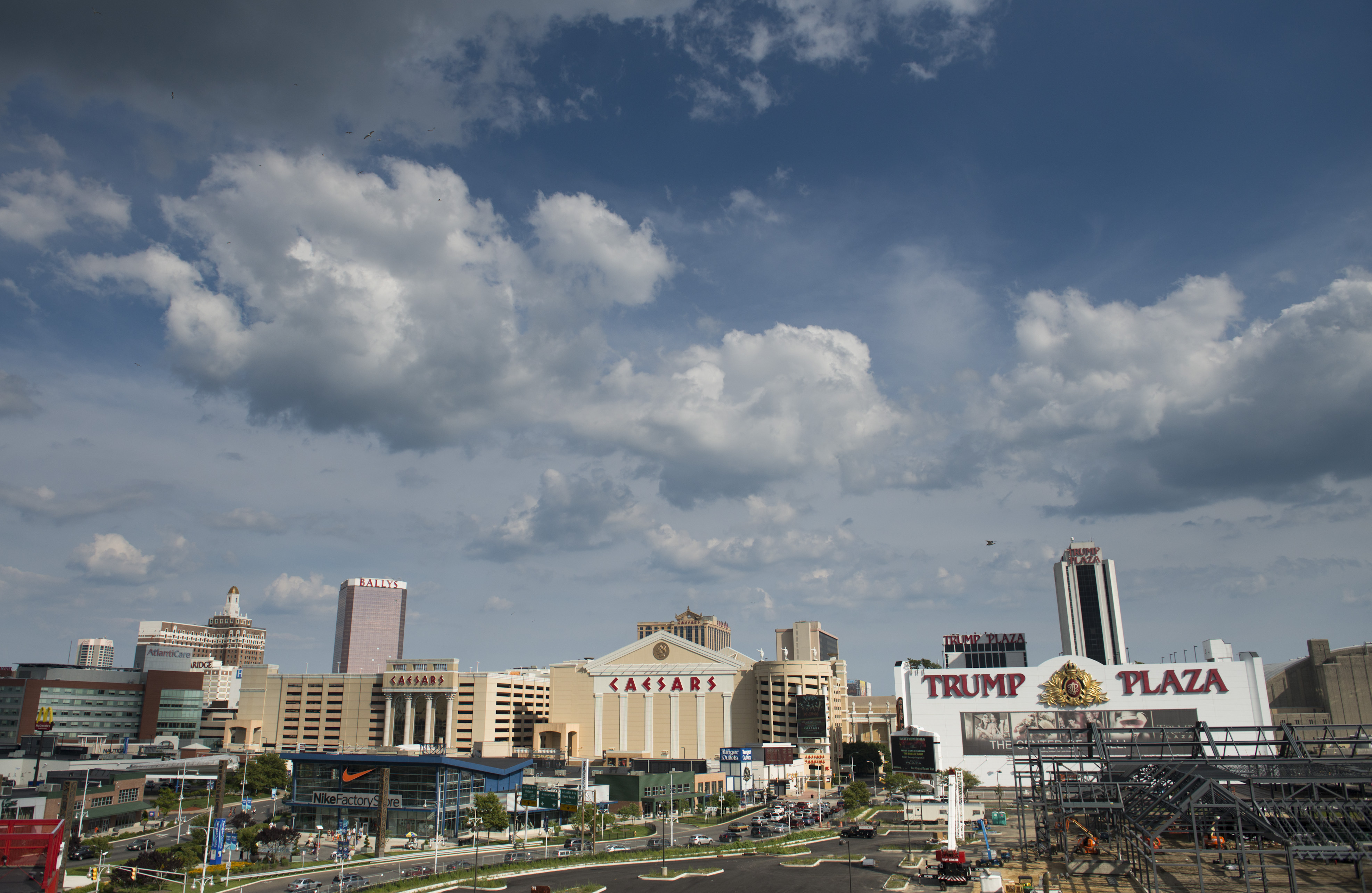Caesars Entertainment, Atlantic City Hotel and Casino, and the Trump Plaza Hotel and Casino stand in Atlantic City, New Jersey, U.S., on Thursday, July 17, 2014.