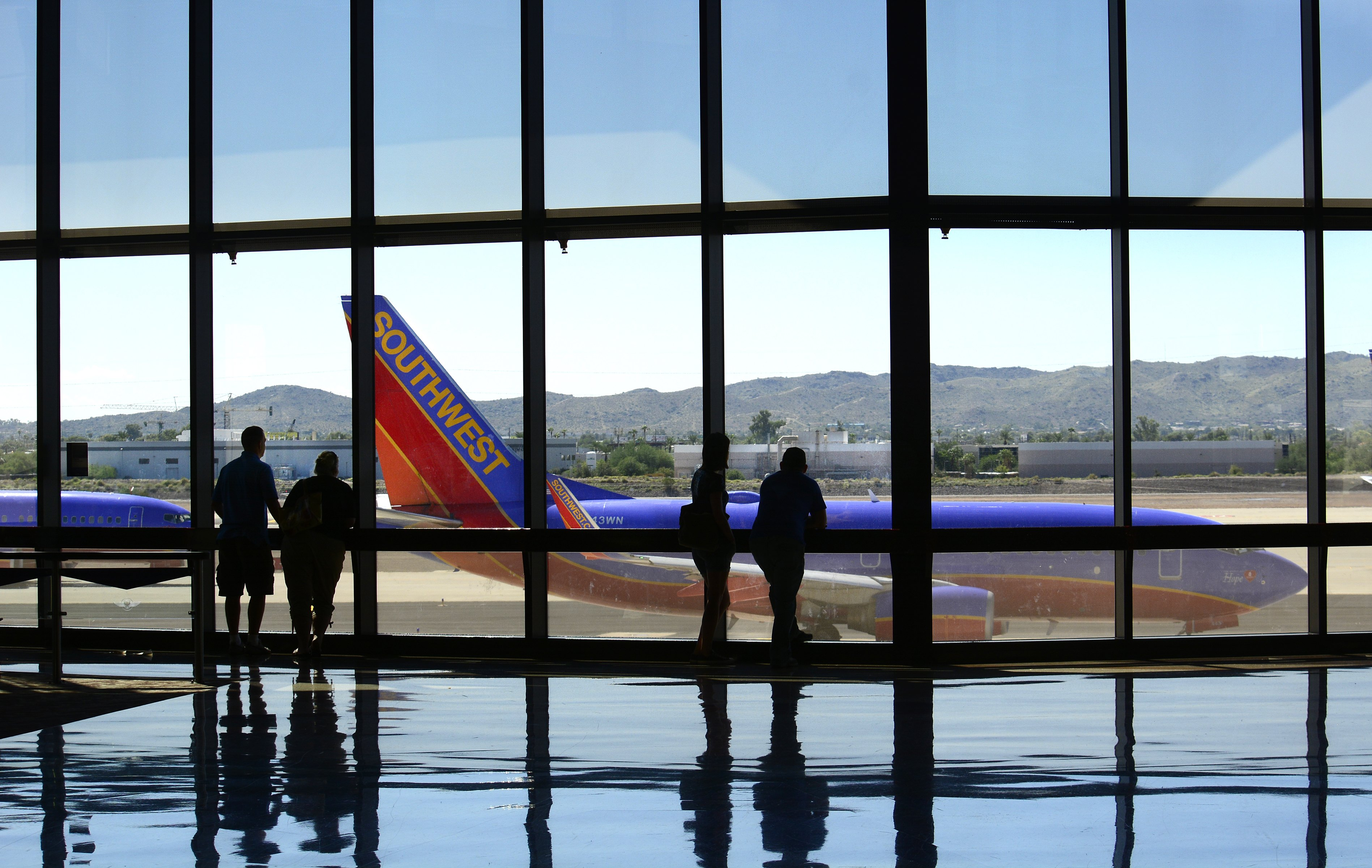 Airline passengers wait for their flights at Phoenix Sky Harbor International Airport.
