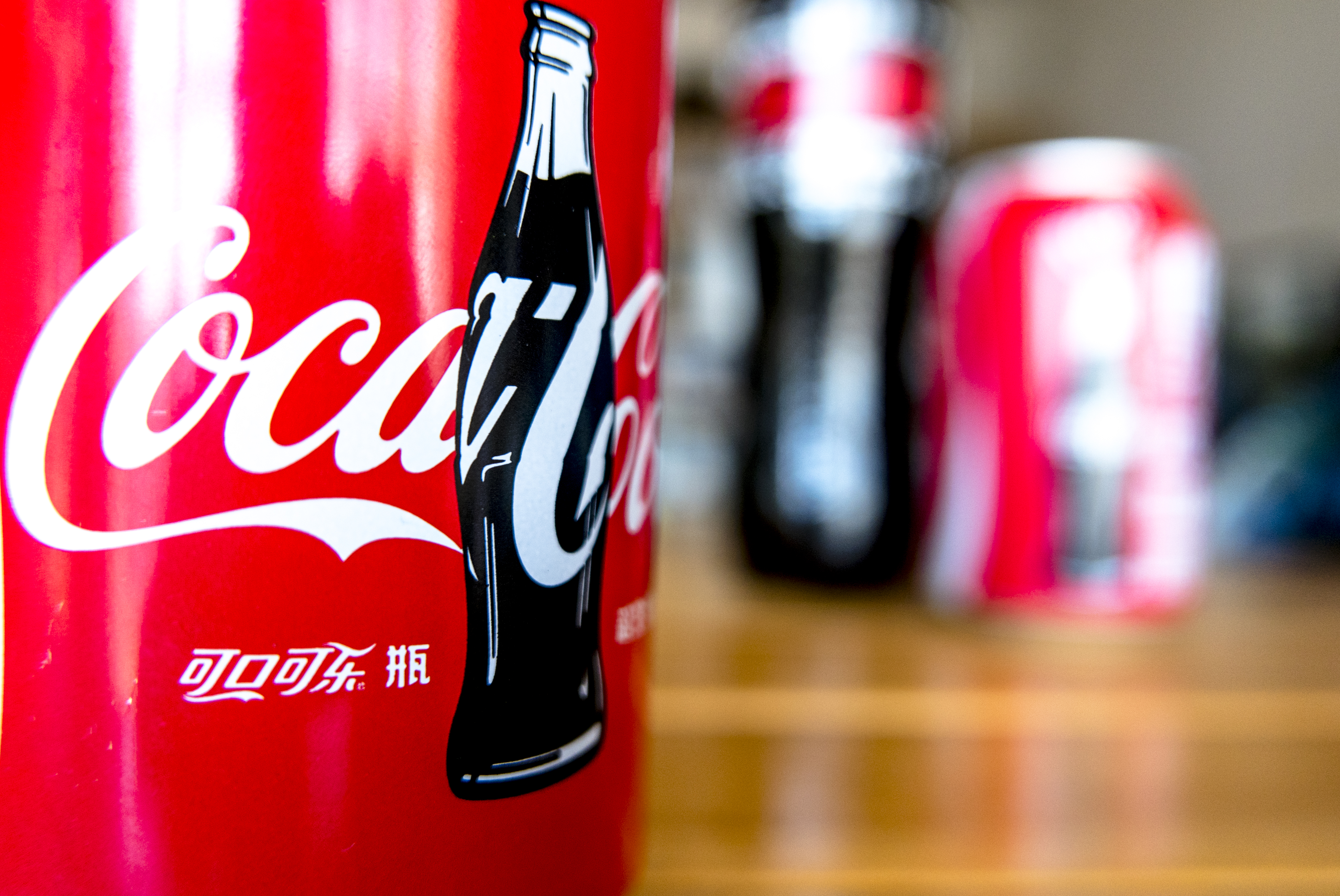 Logo of Coca-Cola on a bottle. The strong dollar hit Coca-