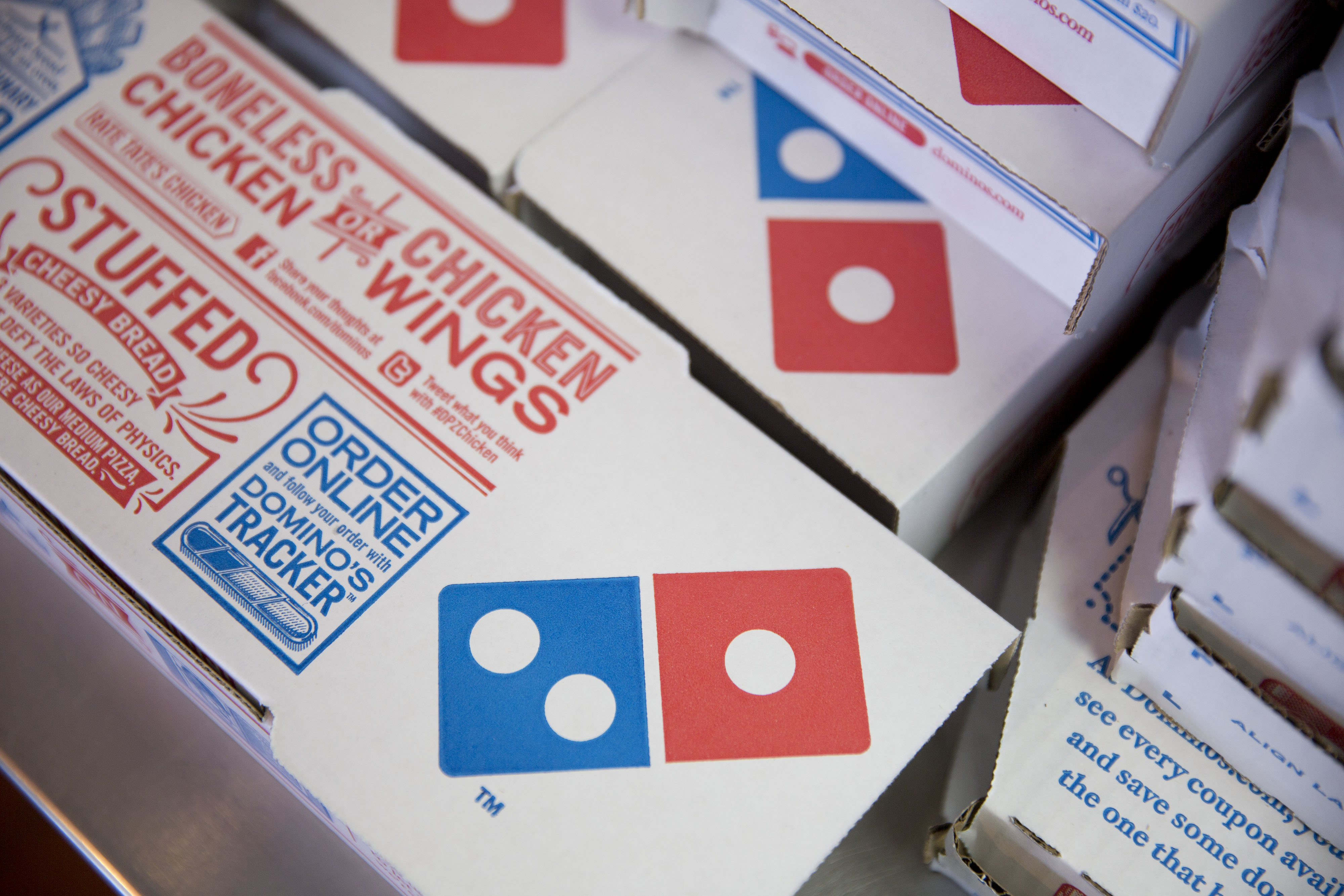 Boxes sit stacked at a Domino's Pizza Inc. restaurant.