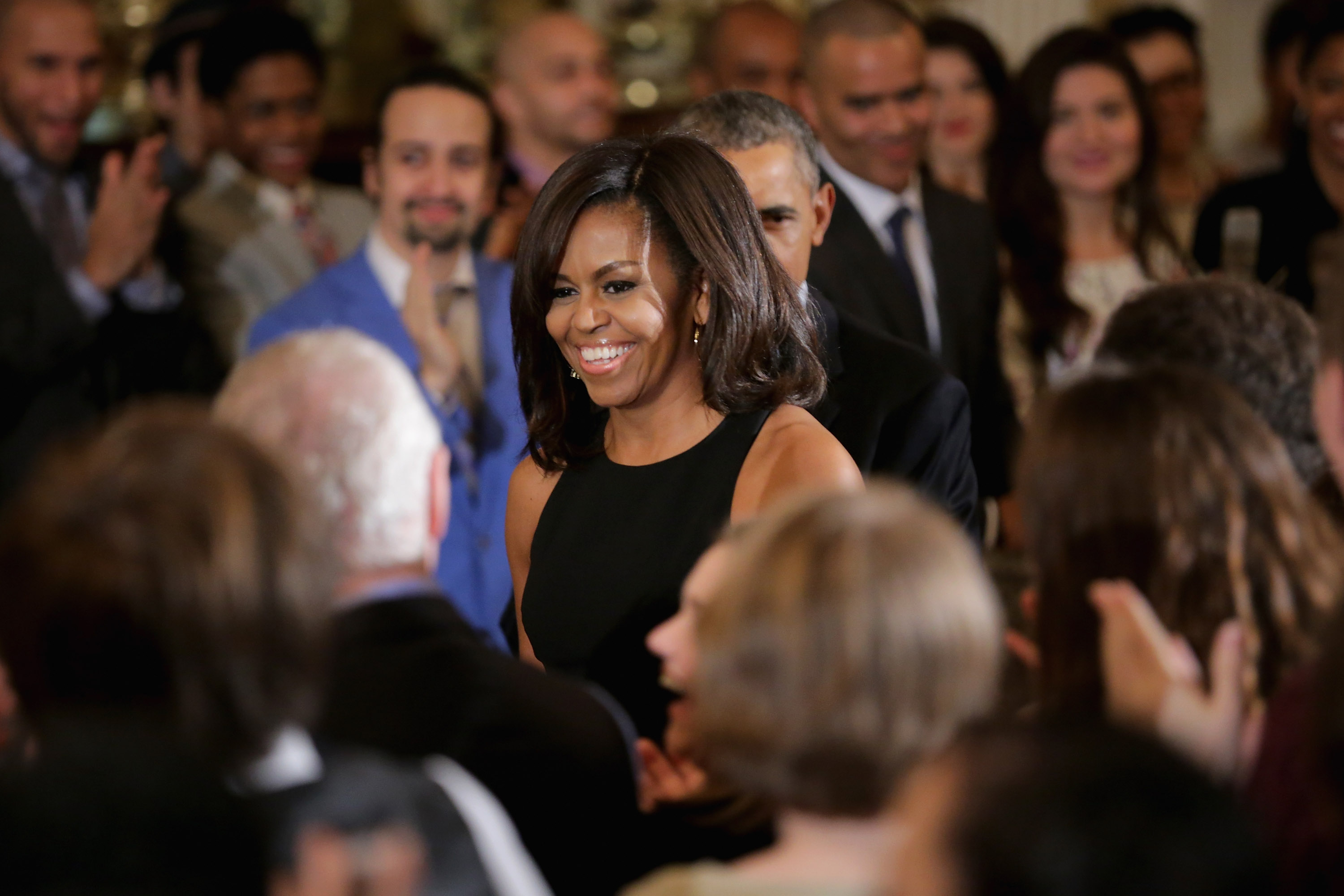 First lady Michelle Obama (C) arrives for an event in the East Room of the White House.