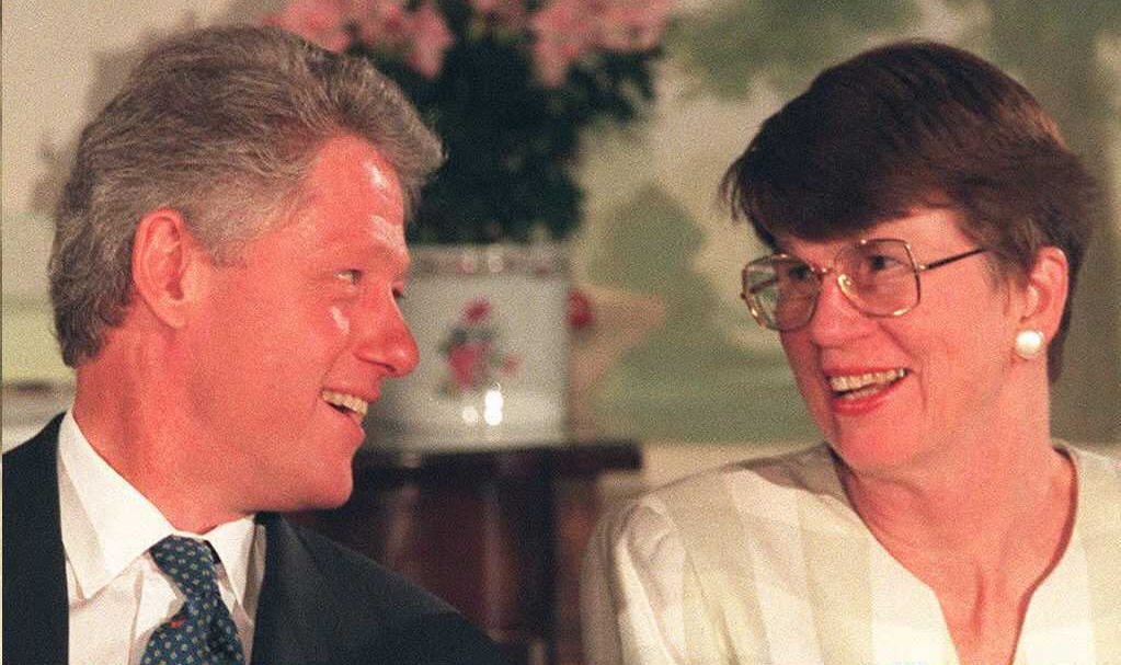 US President Bill Clinton(L) smiles at US Attorney