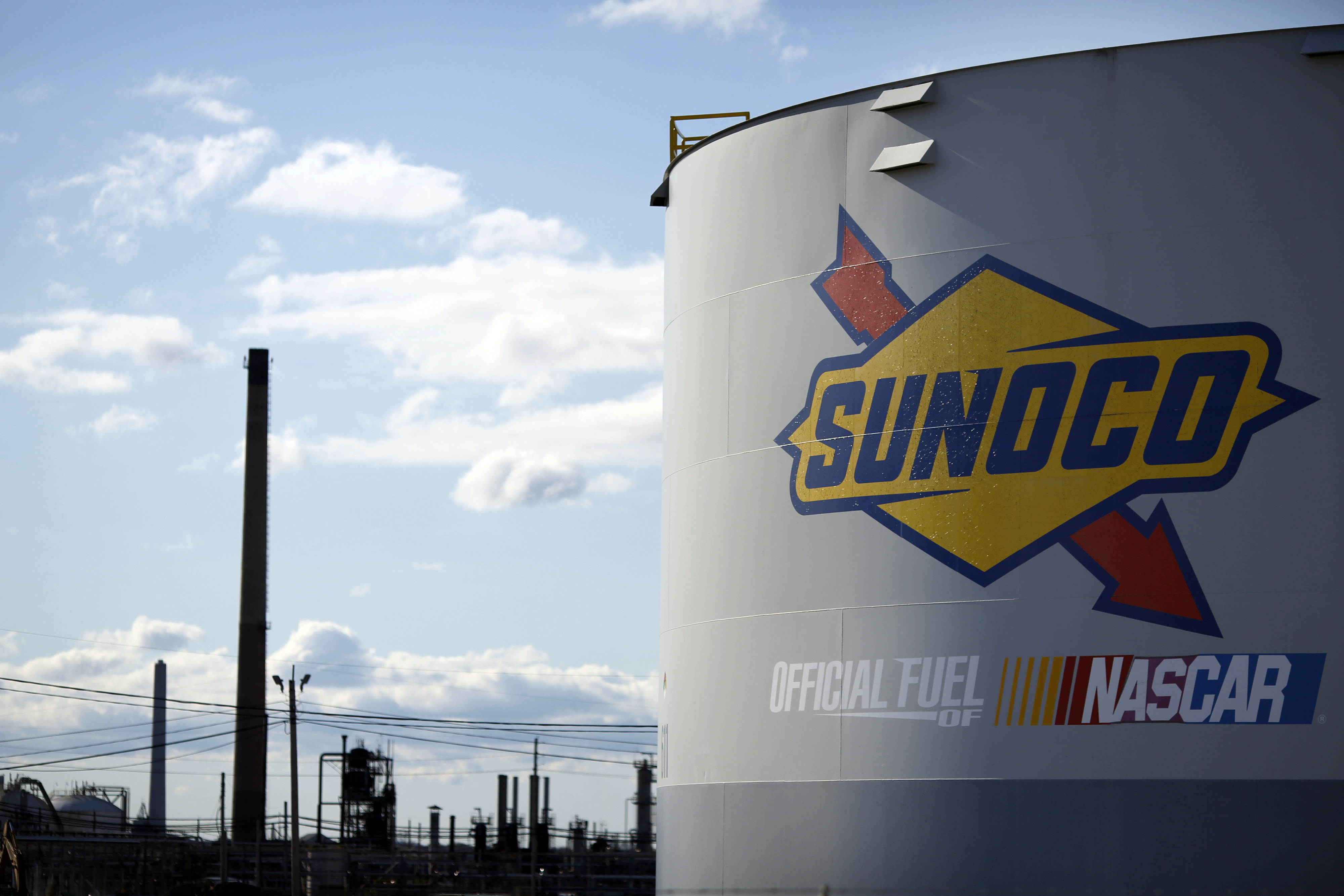 Signage is displayed on a former oil storage tank on the grounds of the Sunoco Logistics Marcus Hook Industrial Complex ethane terminal in Pennsylvania.