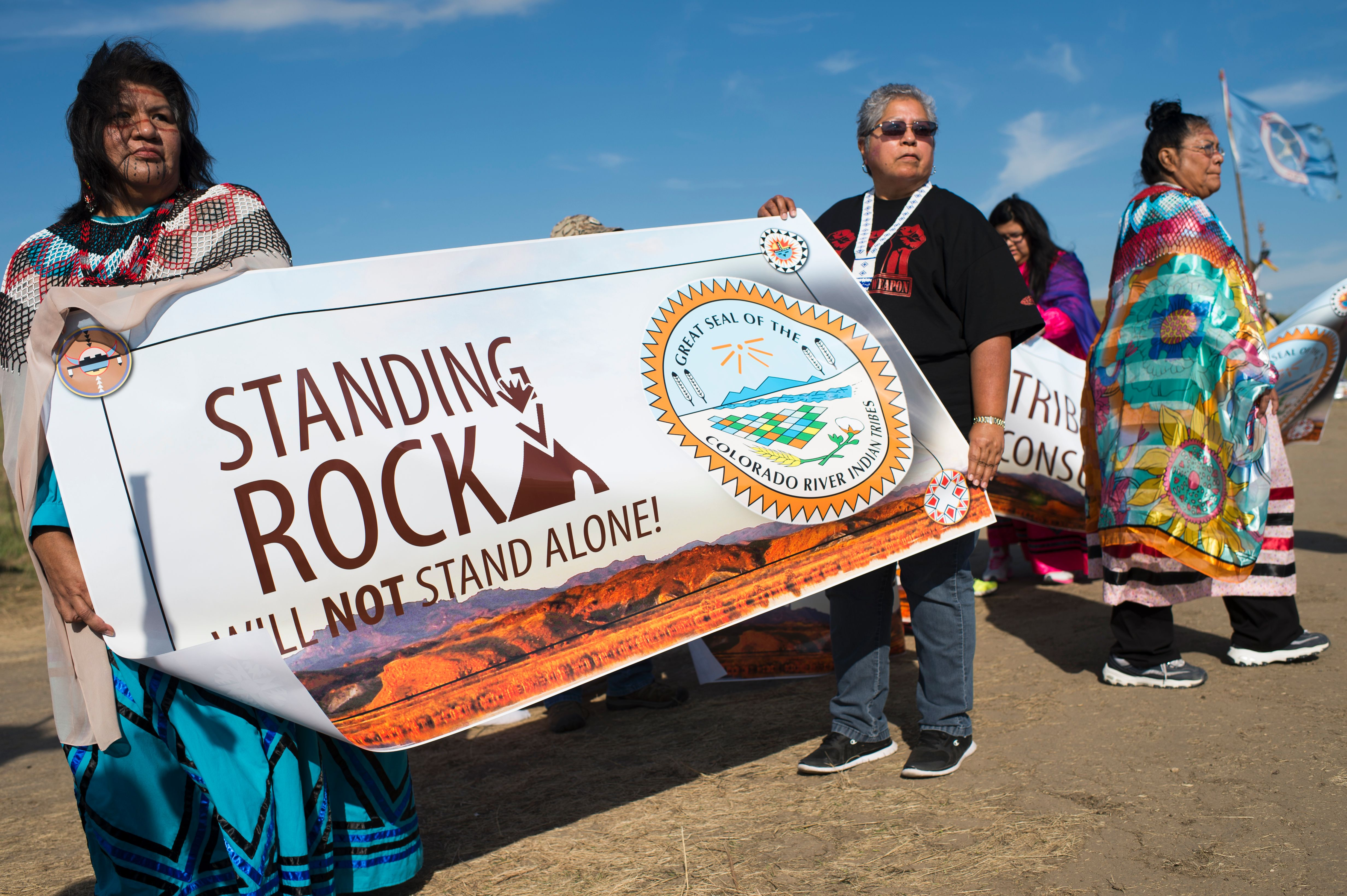 Members of the Colorado River Tribes hold a banner to show their support for those who oppose the construction of the Dakota Access Pipeline.