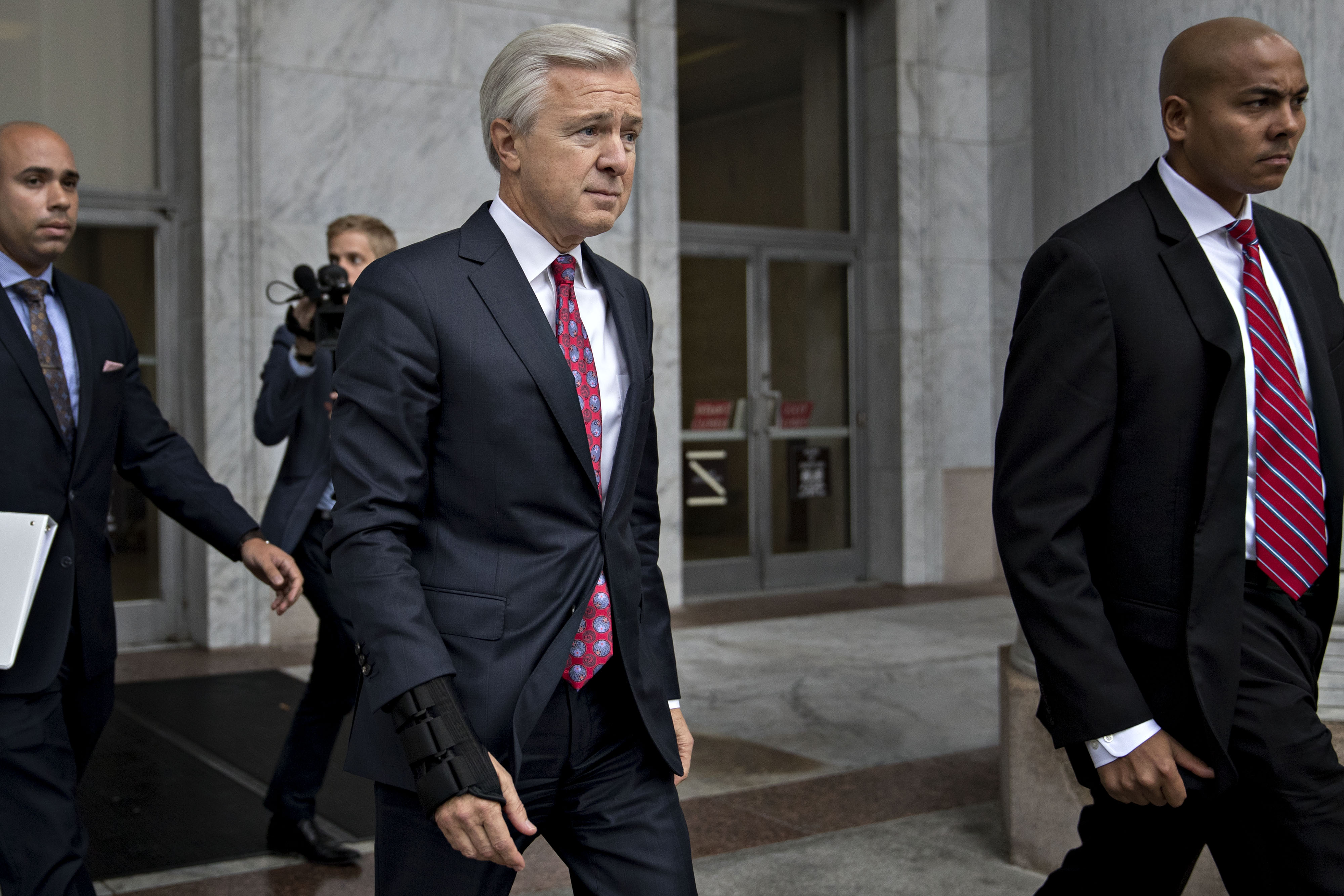 Former Wells Fargo CEO John Stumpf exits the Rayburn House Office building after a House Financial Services Committee hearing in Washington, D.C.