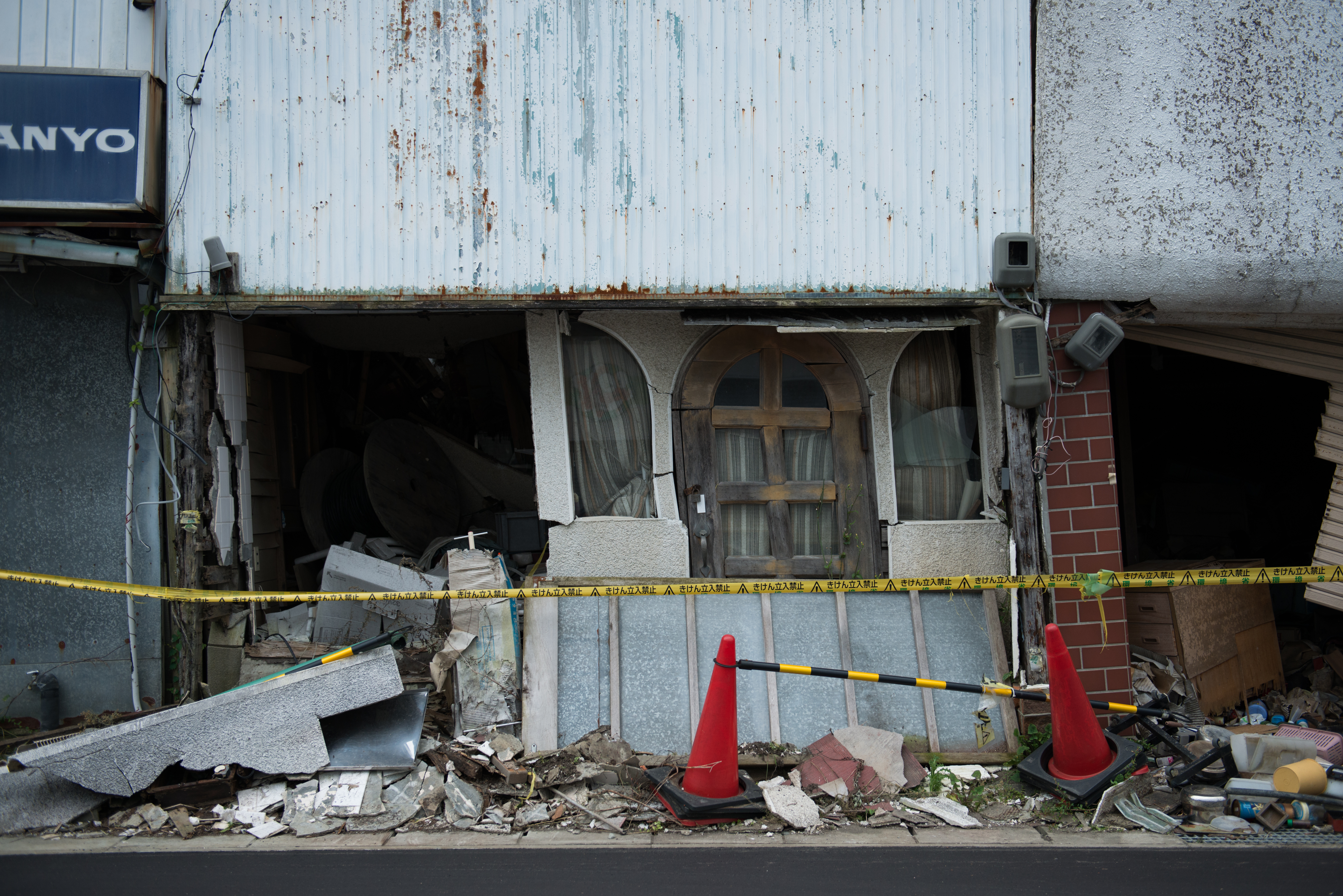 A caution tape is seen in front of a store damaged by the 2011 earthquake and tsunami in Namie, Fukushima.