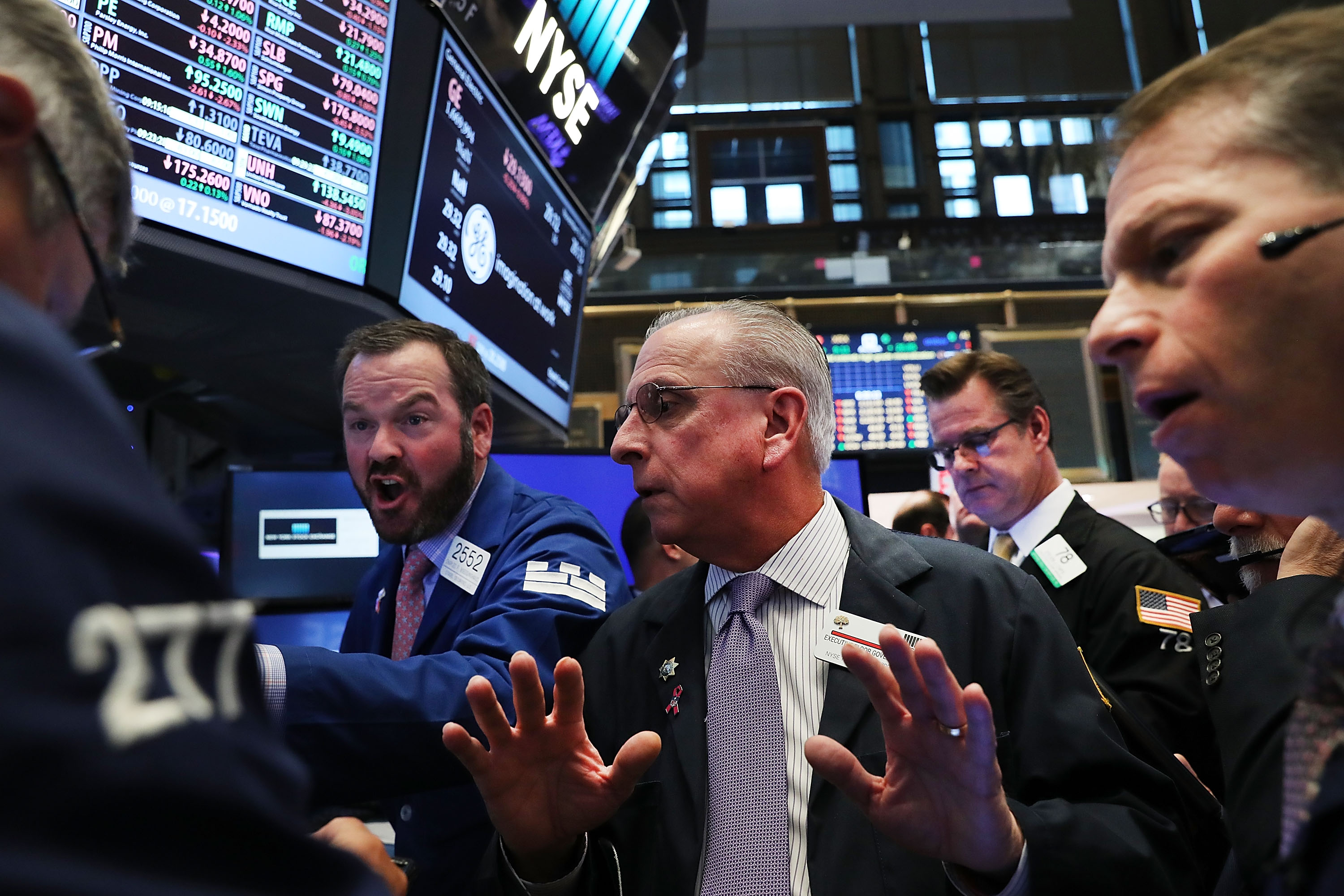 Traders work on the floor of the New York Stock Exchange (NYSE) the morning after Donald Trump won the presidential election on November 9, 2016.