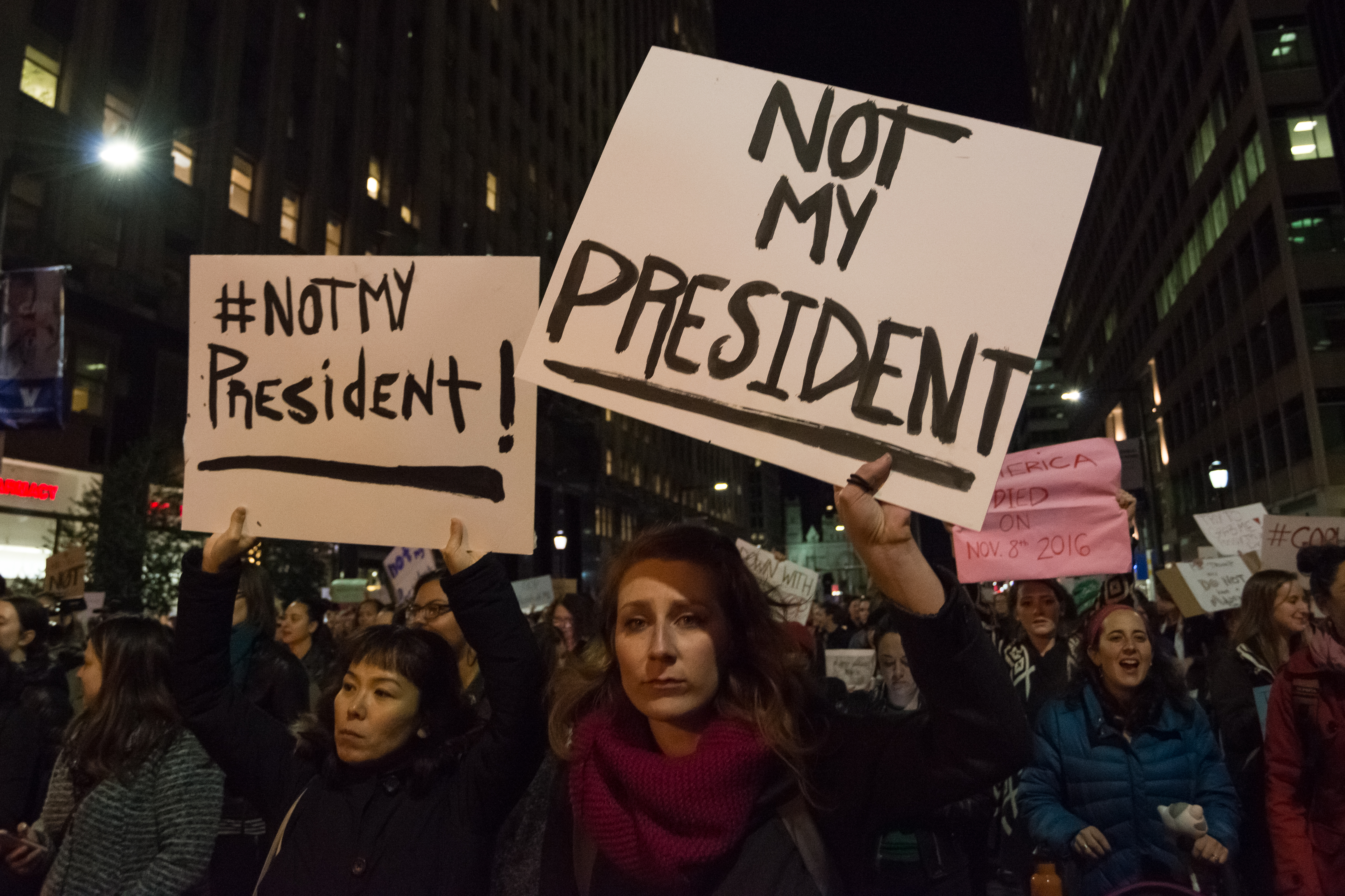 Demonstrators in downtown Philadelphia decry the political agenda of President-elect Donald J. Trump.