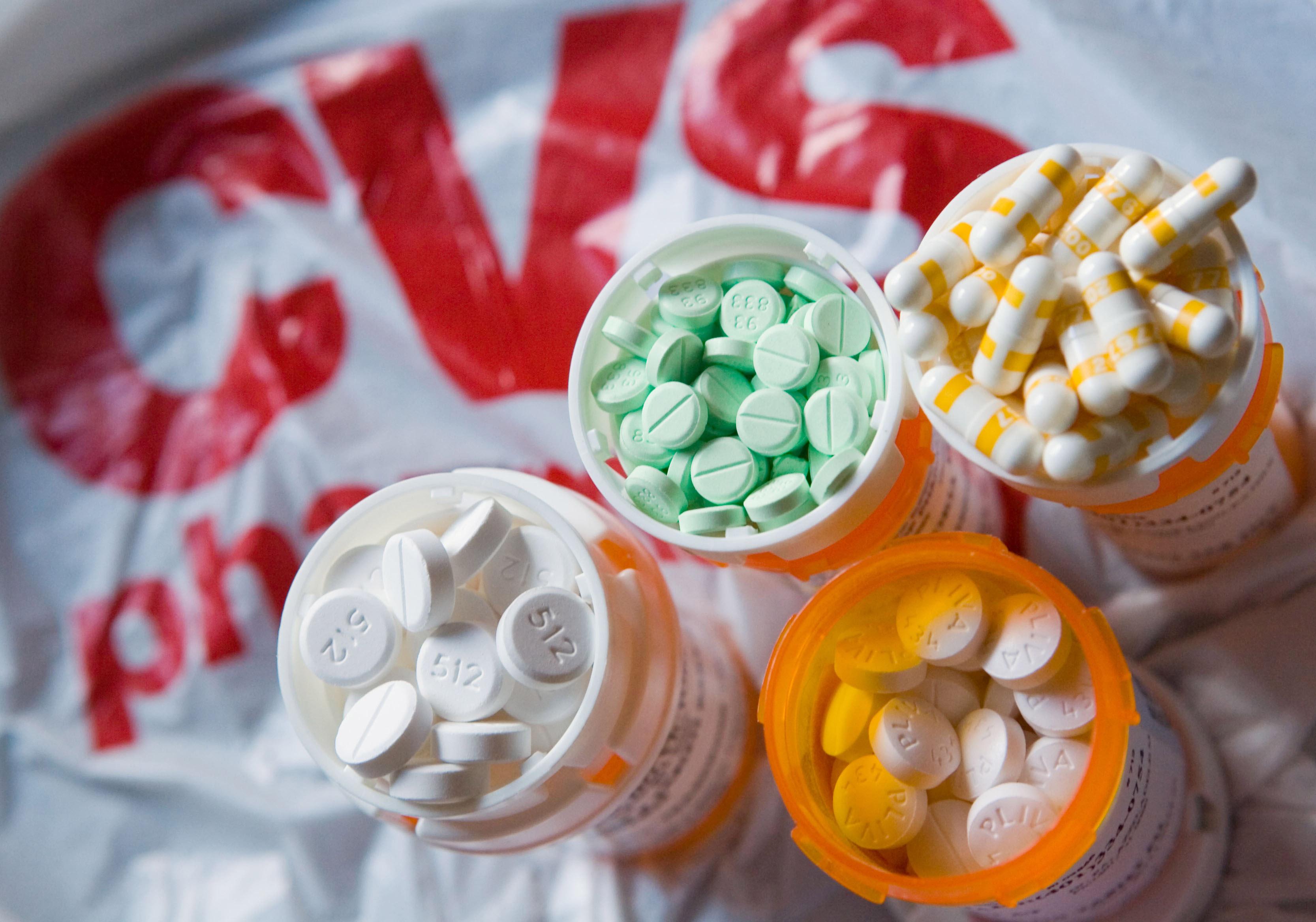 Prescription medication frames the CVS logo.