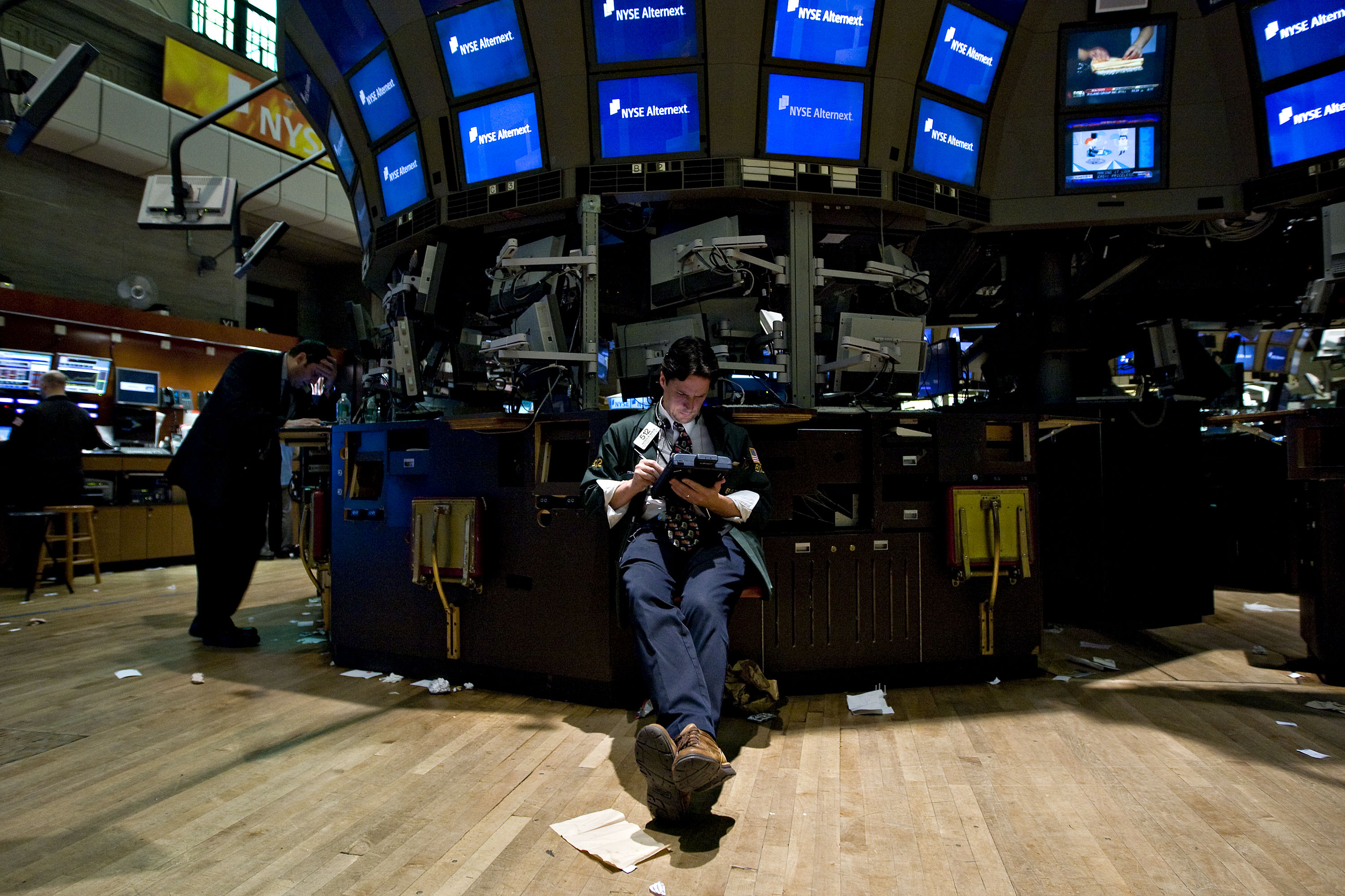 A trader works at a vacant post on the floor of the New York