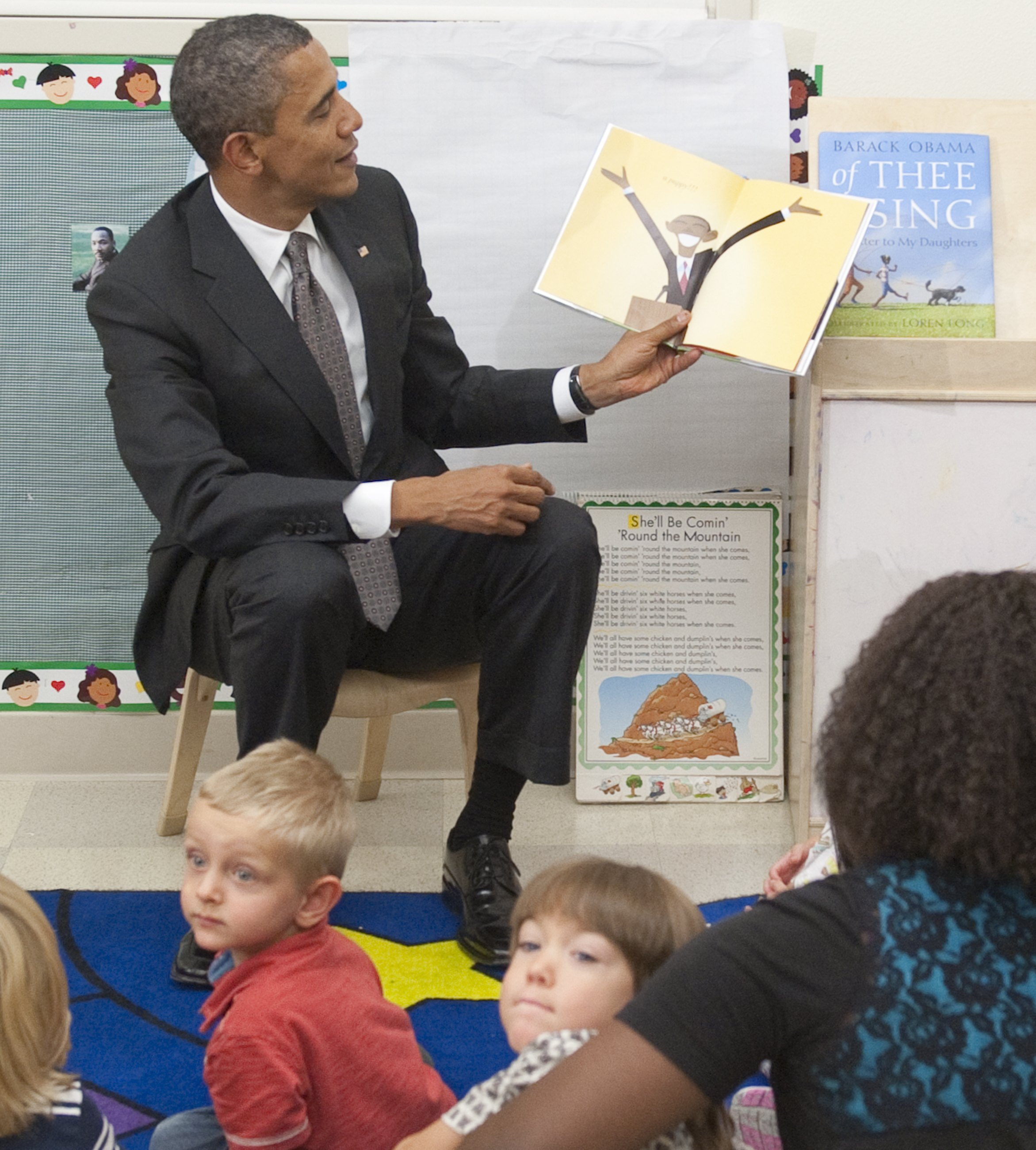 US President Barack Obama holds up a boo